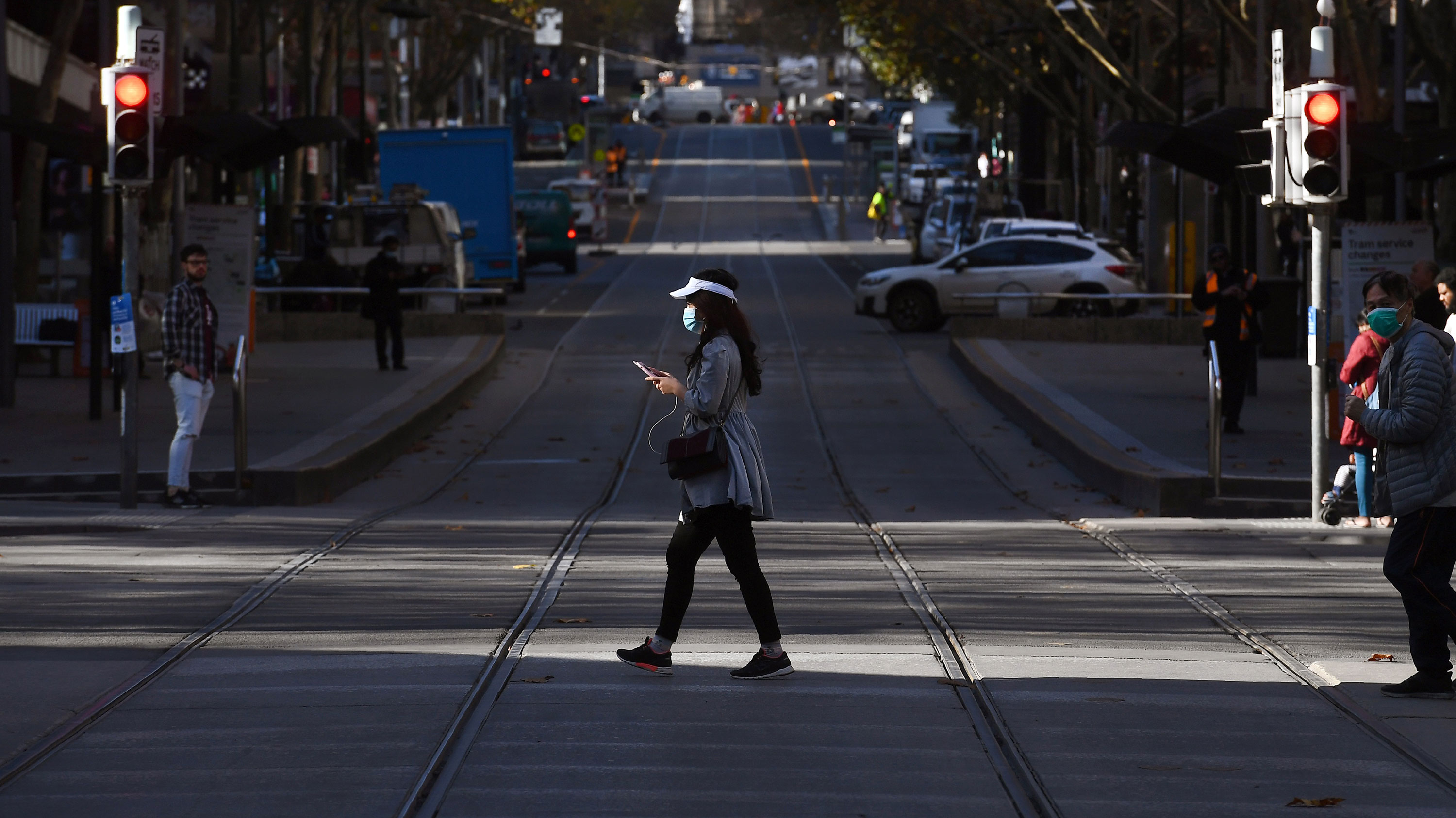 A woman wears a face mask while walking through Melbourne's business district on June 17.