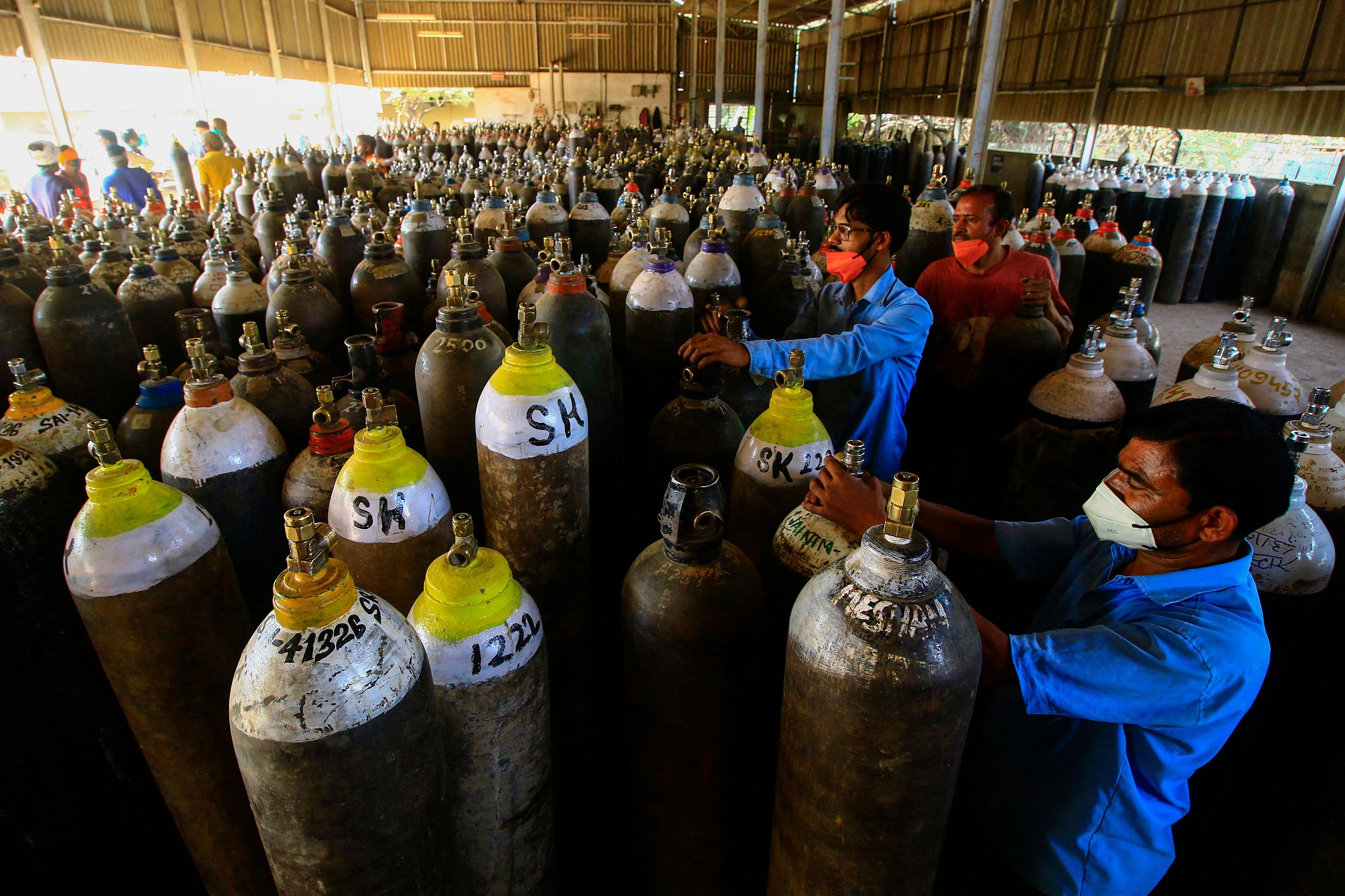 Workers are preparing to fill oxygen cylinders for hospital treatment of Covid-19 patients on the outskirts of Jabalpur, India on April 18.