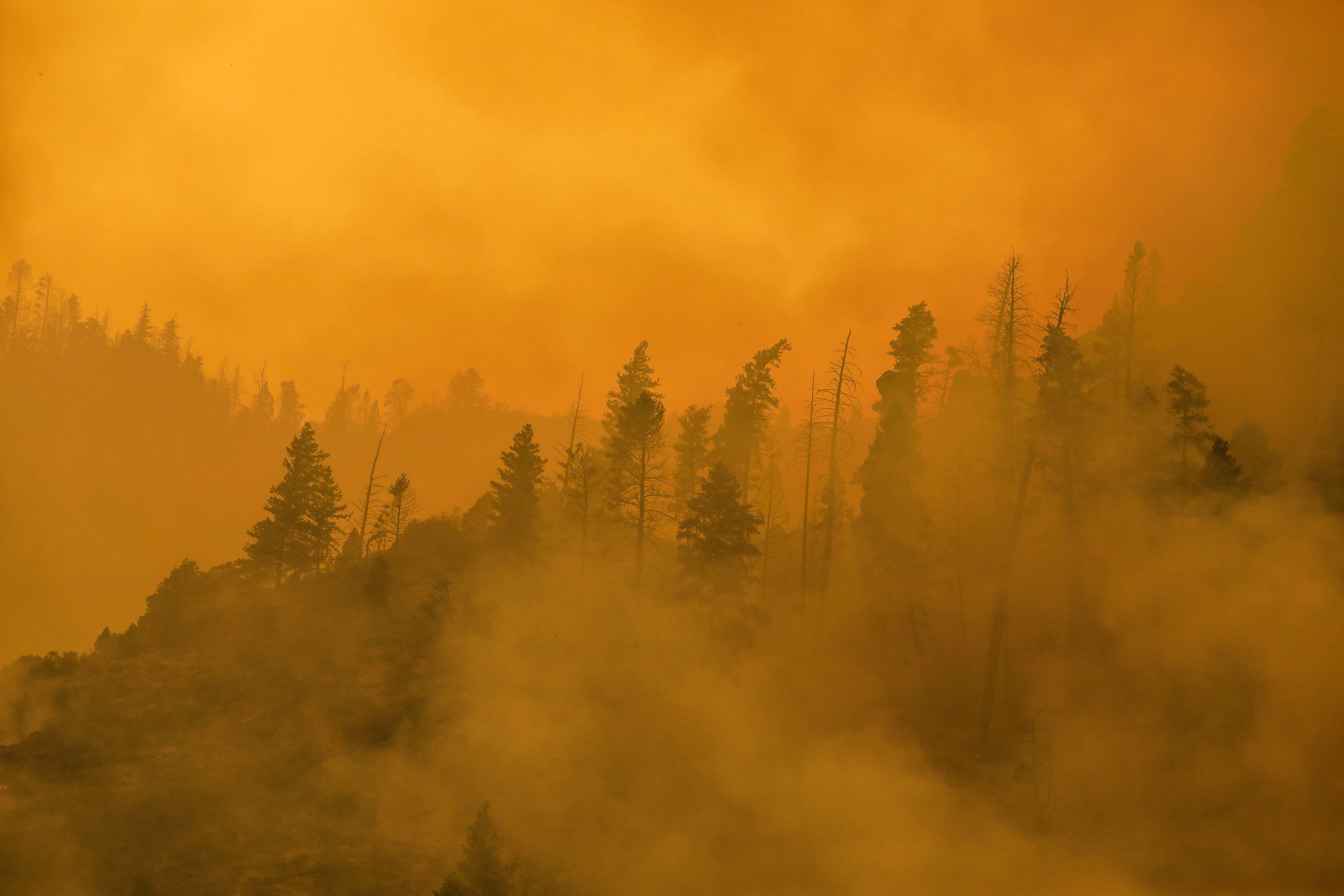 Smoke is thick in Glenwood Canyon from the Grizzly Creek fire near Glenwood Springs, Colorado, on August 16.