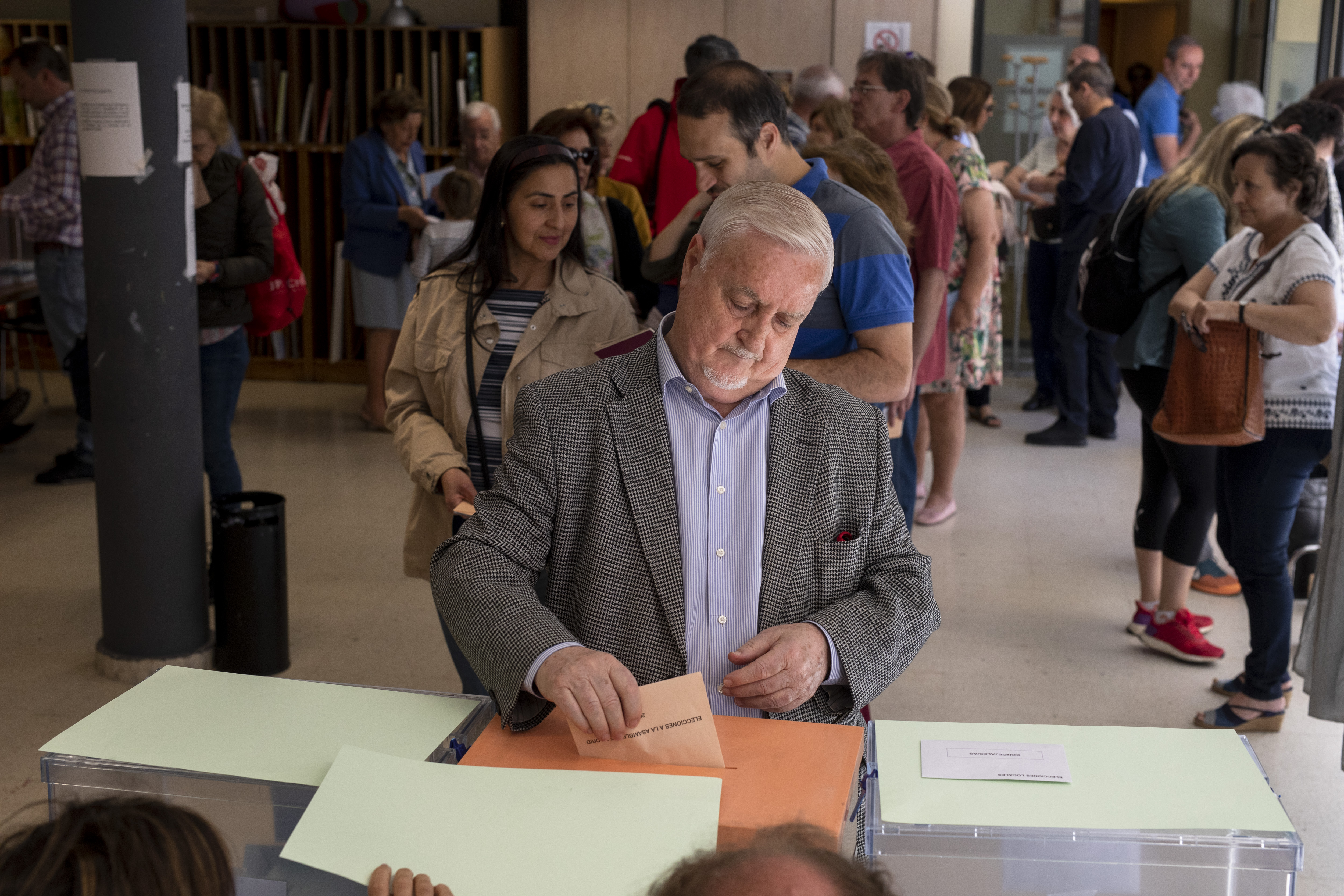 A man casts his ballot at a polling station during voting for the Spanish local, regional and European parliamentary elections on May 26.