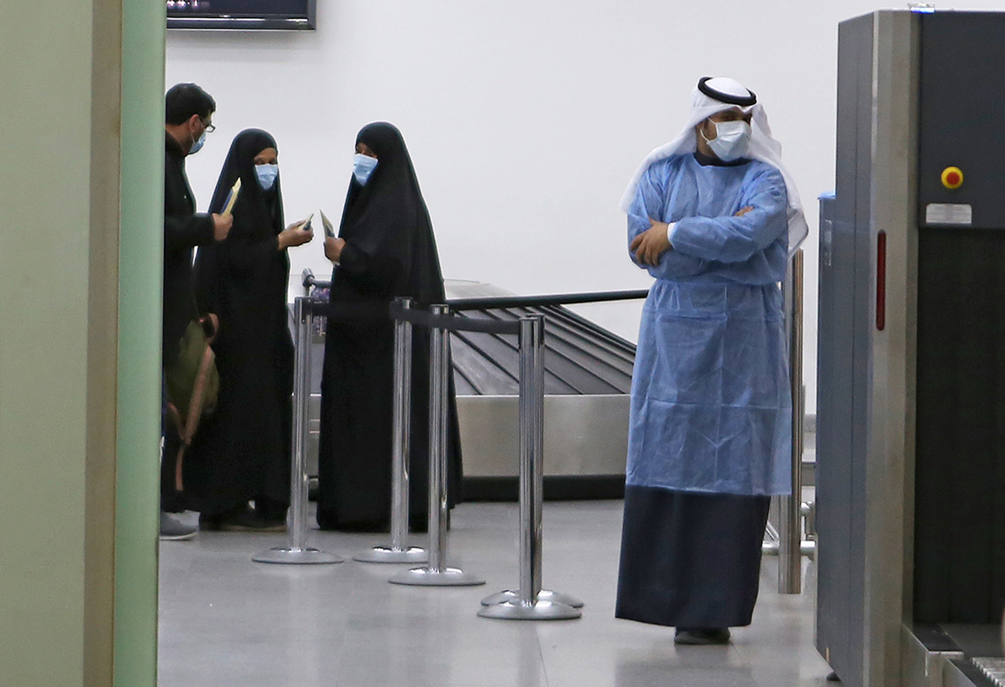 Kuwaitis coming back from Iran wait at Sheikh Saad Airport in Kuwait City on February 22 before being taken to a hospital to be tested for coronavirus.