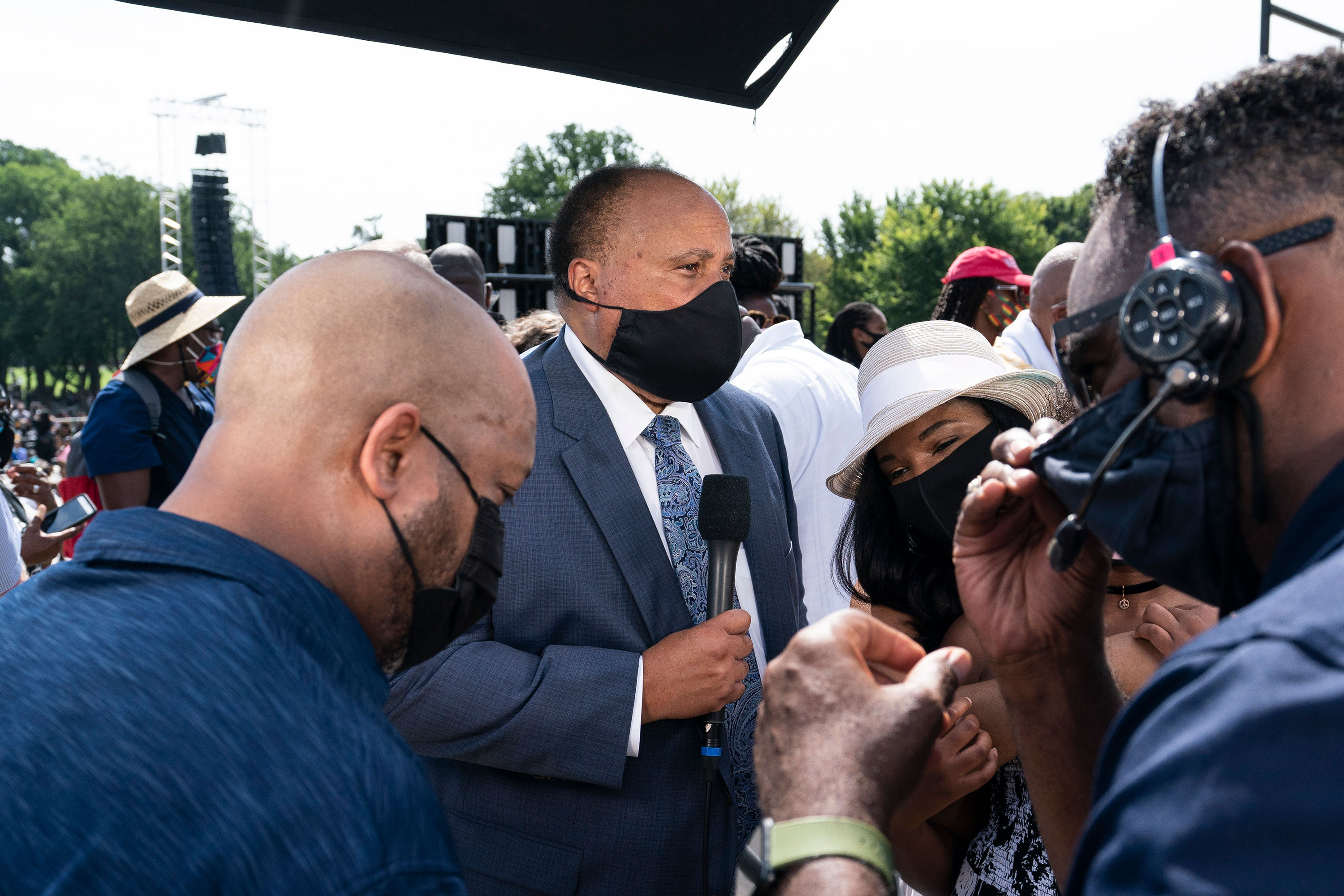 Martin Luther King III, second from left, prepares for a television interview at the March on Washington on August 28.