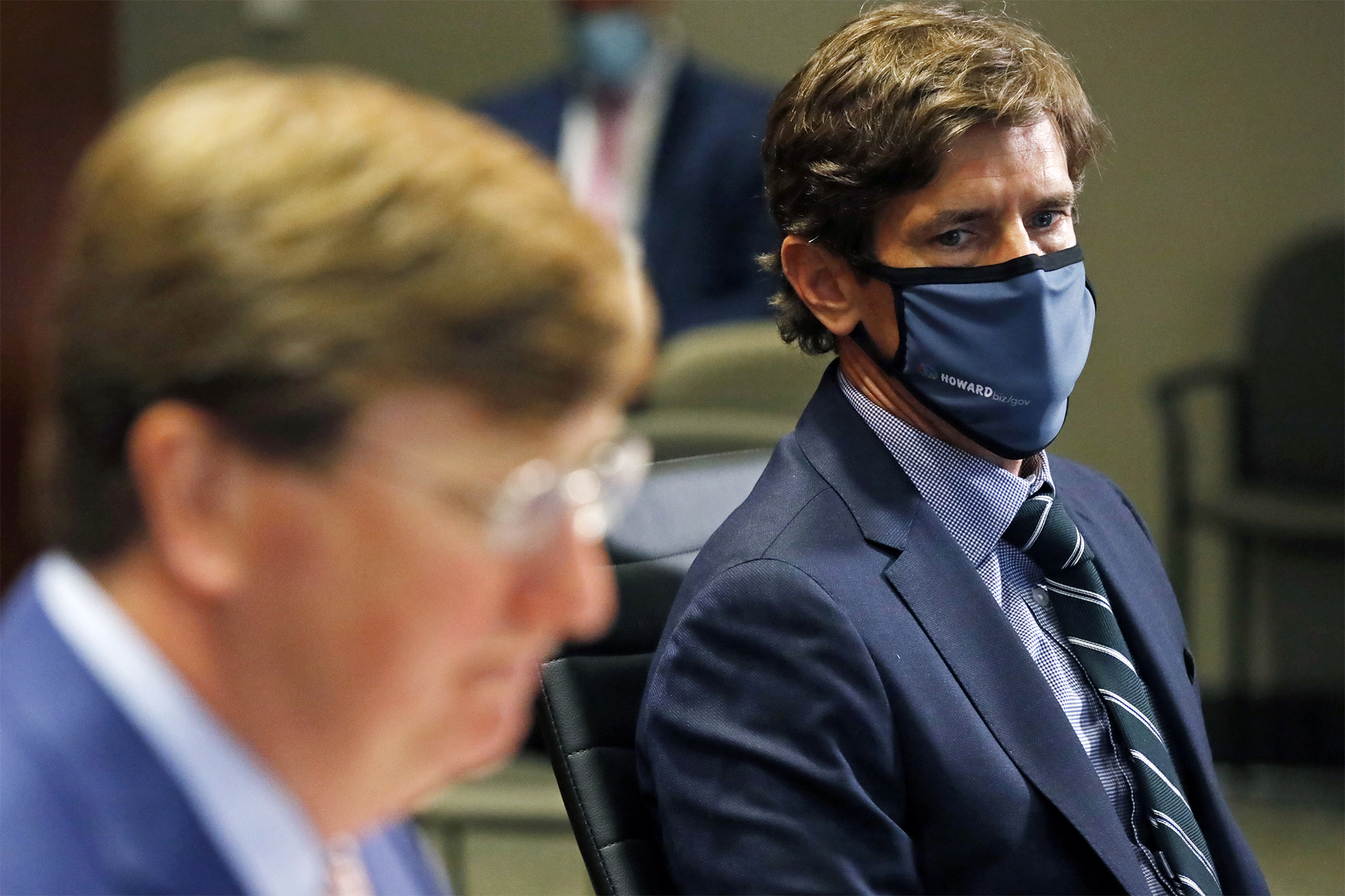 Mississippi State Health Officer Dr. Thomas Dobbs, right, listens as Gov. Tate Reeves responds to a reporter's question during the governor's Covid-19 press briefing in Jackson, Mississippi on Tuesday, August 4.