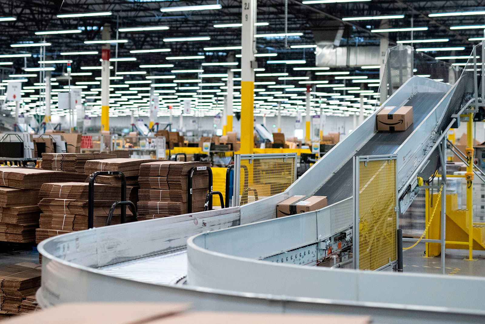 Packages move along a conveyer belt inside Amazon's fulfillment center in Kent, Washington, in 2018.