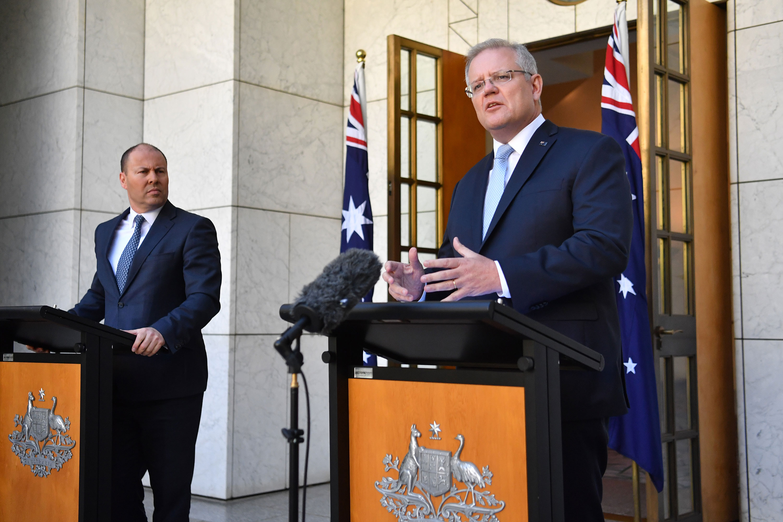 Prime Minister Scott Morrison and Treasurer Josh Frydenberg speak during a press conference at Parliament House on March 22 in Canberra, Australia.