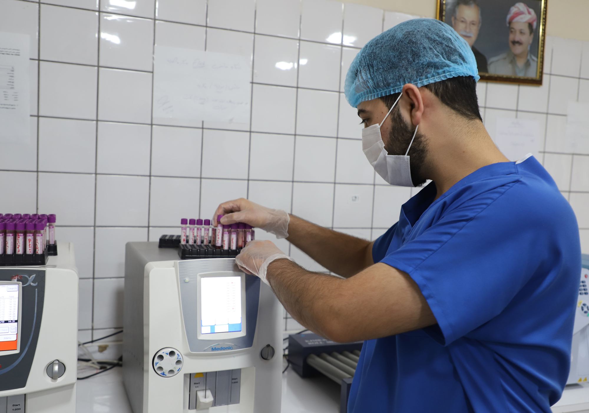 A medical worker tests samples for Covid-19 on October 12 at a hospital in Sulaymaniyah, Iraq.