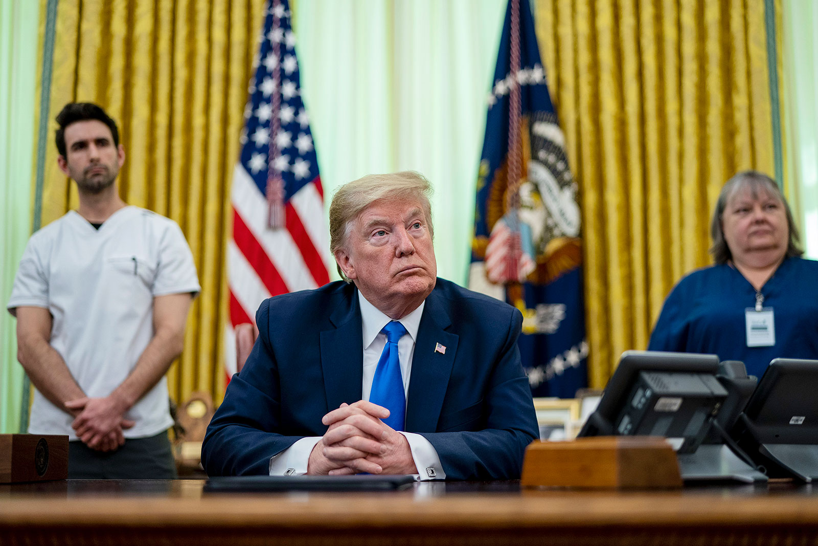 US President Donald Trump talks to reporters after signing a proclamation honoring National Nurses Day in the Oval Office at the White House on Wednesday.