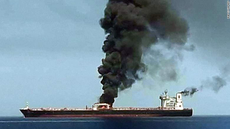 Smoke billowing from a tanker in the Gulf of Oman after a suspected attack.