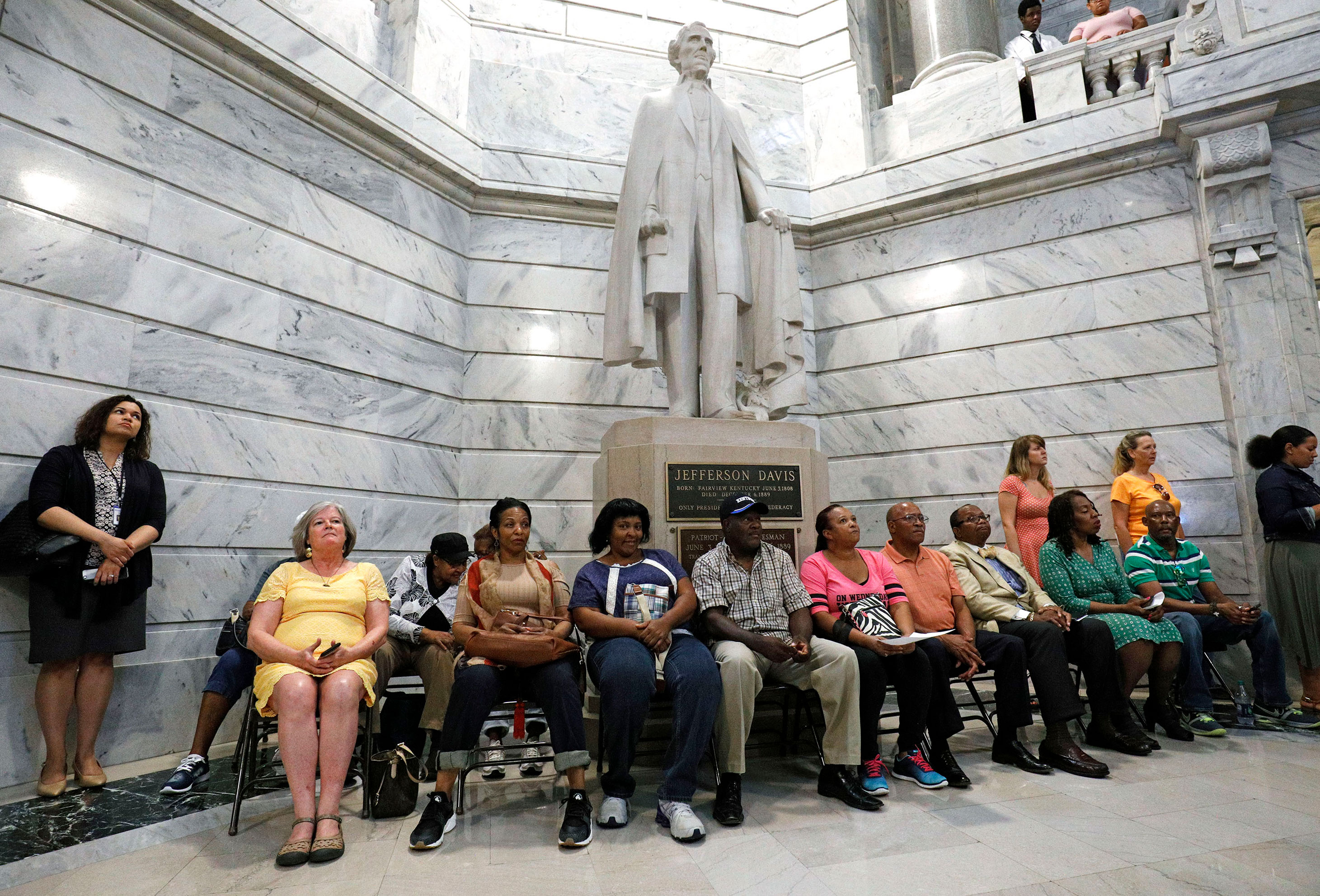 People attend a rally for the removal of a statue of Confederate President Jefferson Davis from the Kentucky State Capitol rotunda August 30, 2017 in Frankfort, Kentucky.