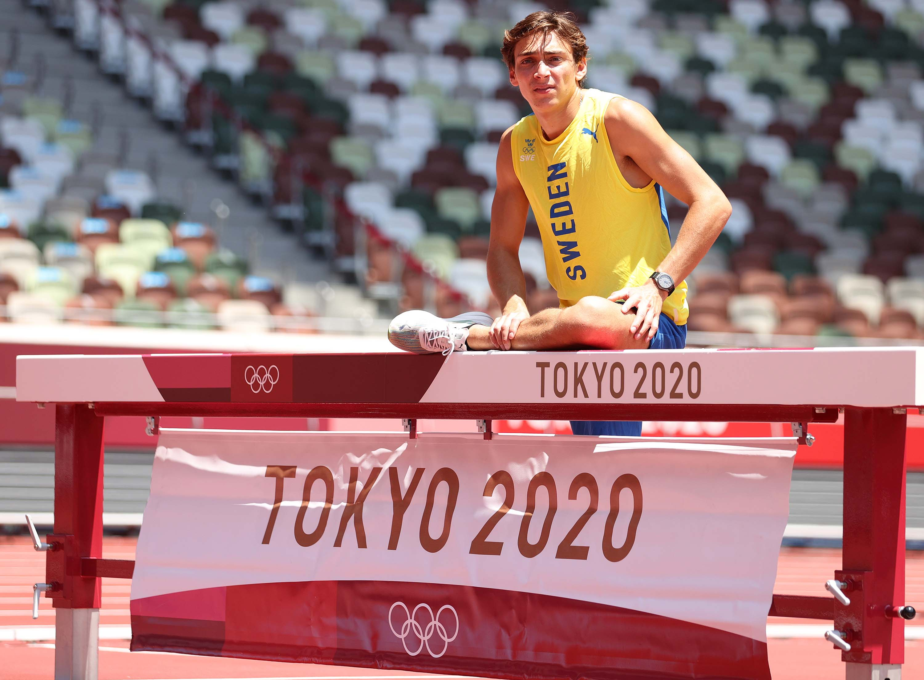 Pole vaulter Armand Duplantis of Sweden warms up on the track ahead of competition at the National Stadium ahead of competition at the Tokyo Olympic Games.