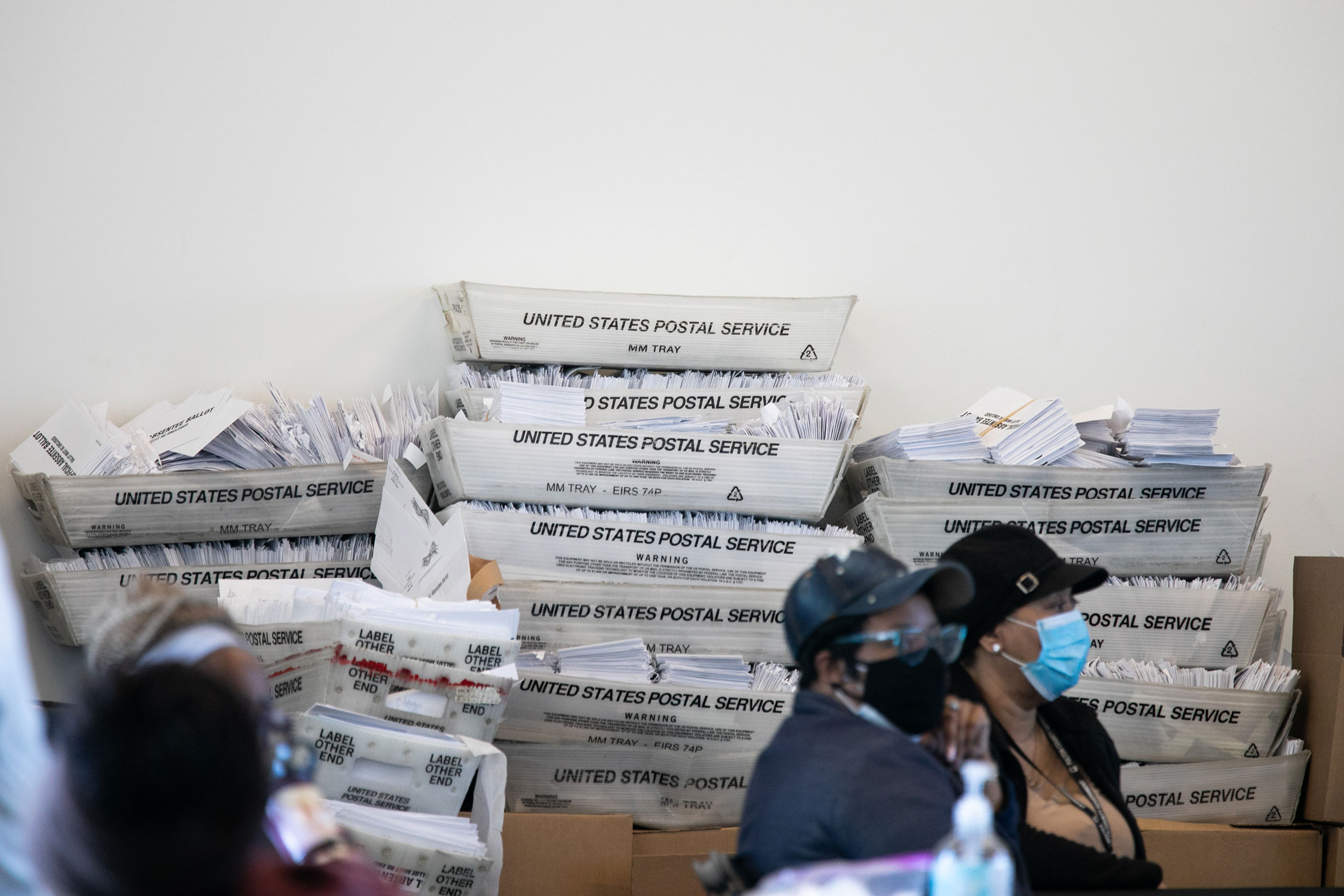 Security envelopes for absentee ballots sit in boxes as Fulton county workers continue to count absentee ballots at State Farm Arena on November 6 in Atlanta, Georgia.