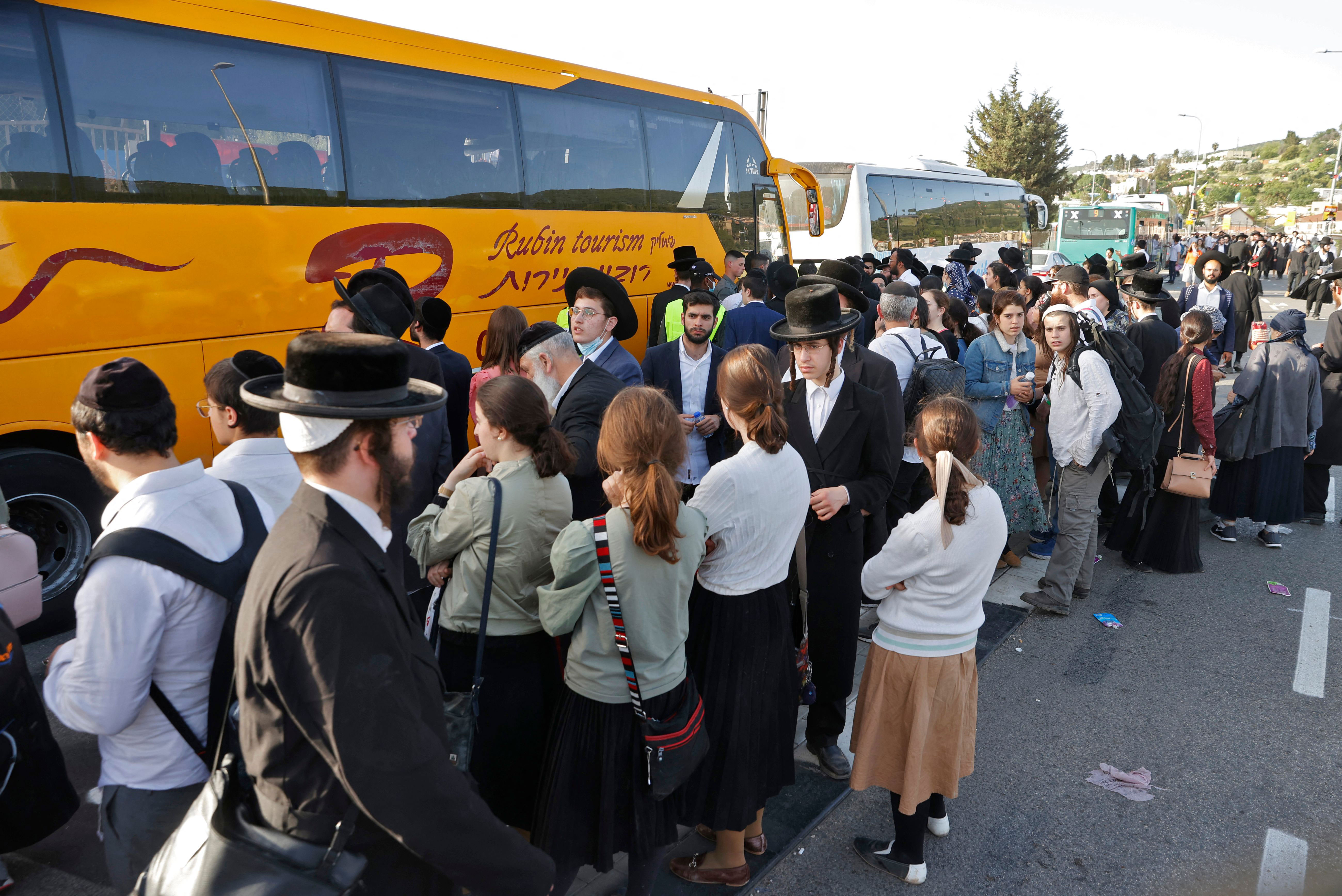 People wait to be evacuated by buses on April 30 in Meron, Israel, following the Lag B'Omer festival.