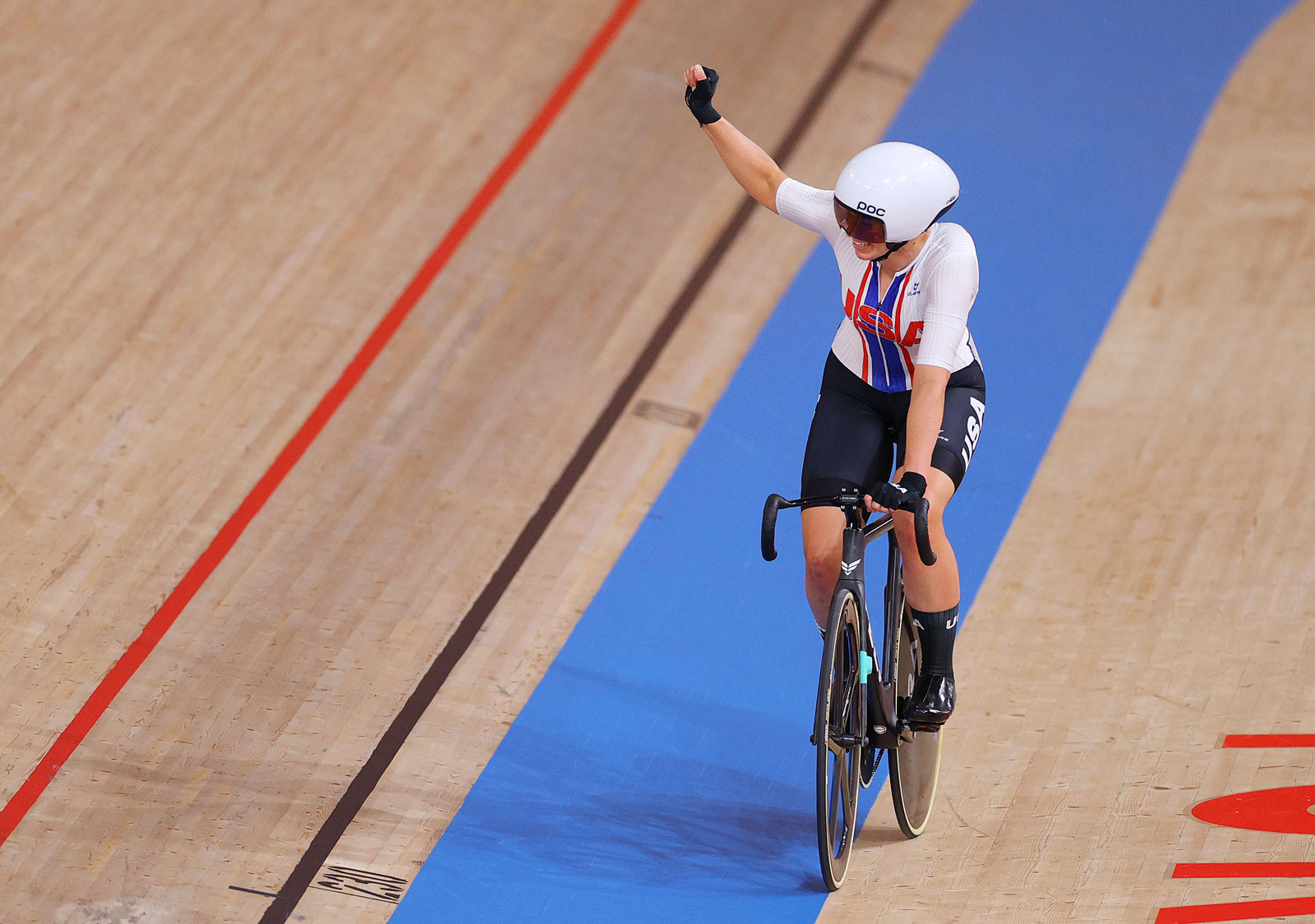 Jennifer Valente waves to spectators aft celebrates winning the gold medal during the omnium cycling competition.
