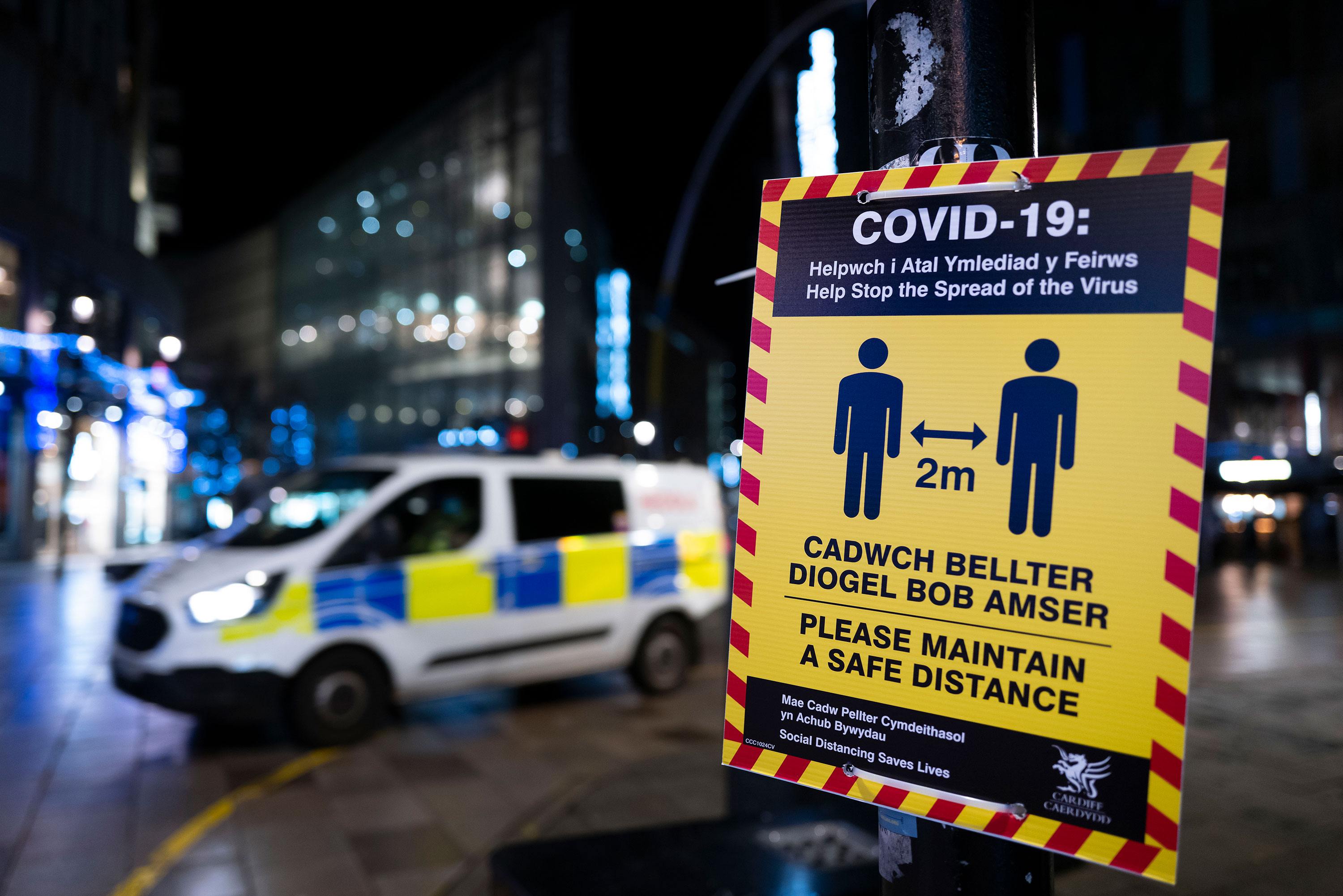 A sign reminds people to socially distance to curb the spread of Covid-19 in Cardiff, Wales, on December 19.