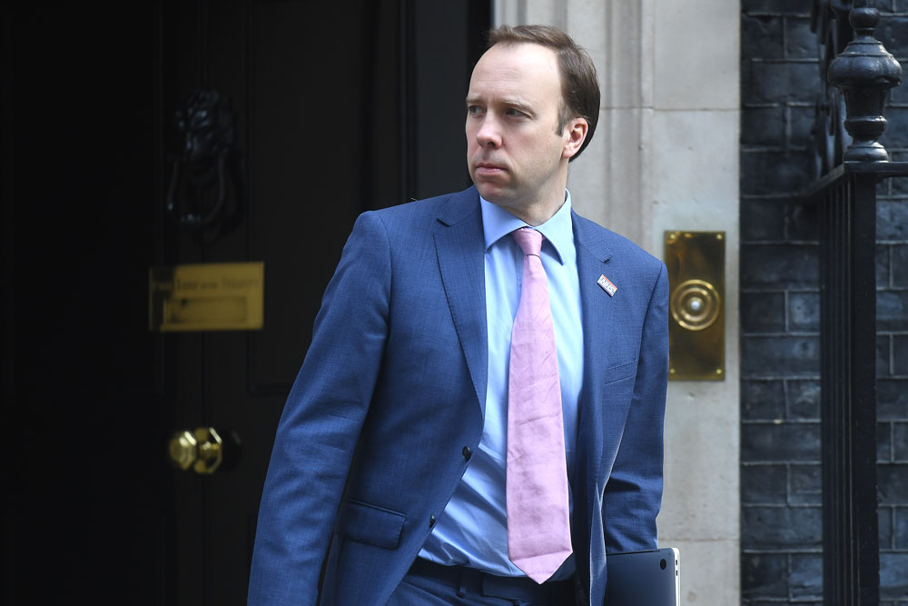 UK Health Secretary Matt Hancock leaves 10 Downing Street on April 9 in London.