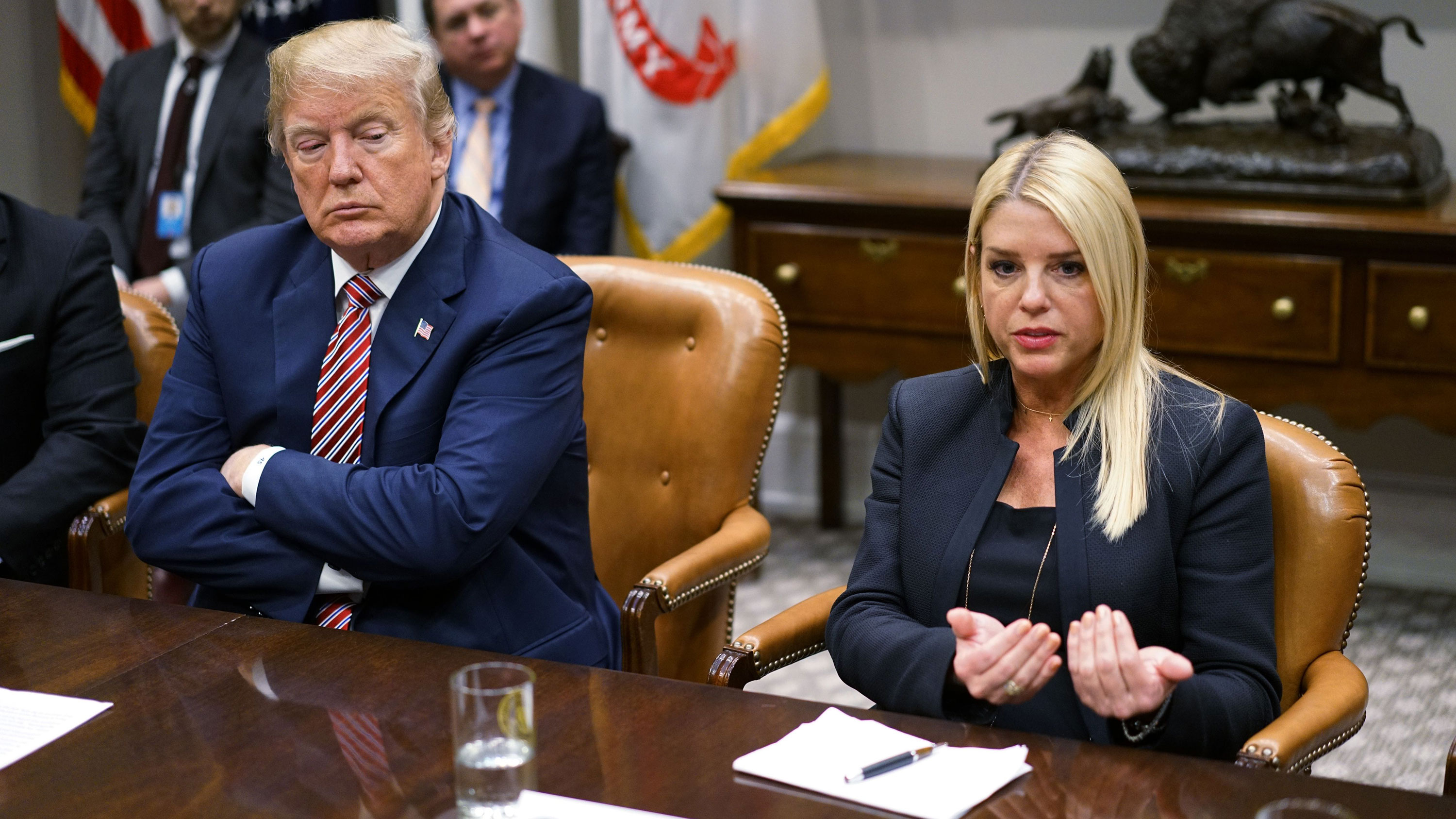 Pam Bondi speaks during a meeting with President Trump in February 2018.