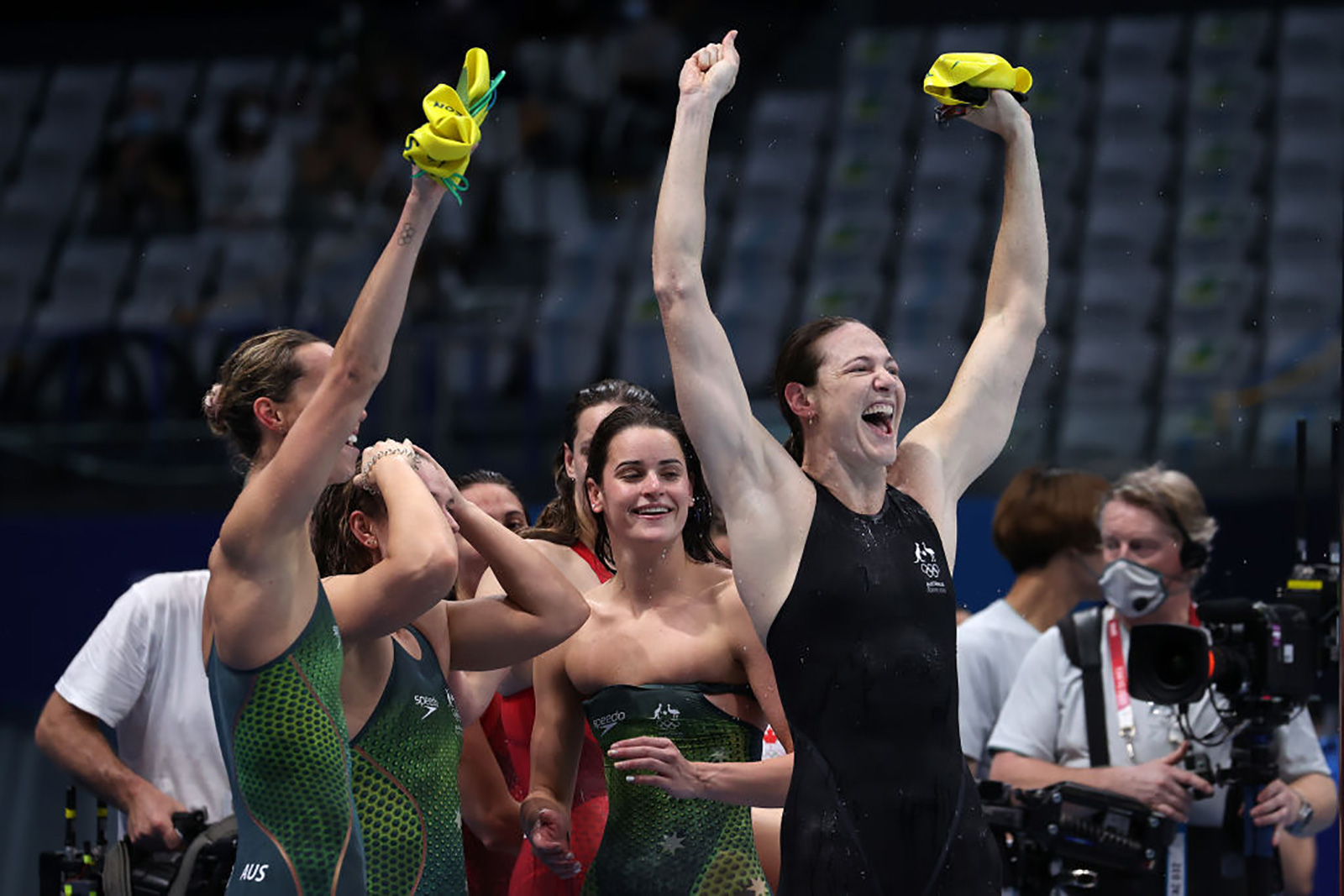Australian swimmers Emma McKeon, Chelsea Hodges, Kaylee McKeown and Cate Campbell react after winning the gold medal and breaking the Olympic recordfor the 4x100 meter medley relay on Sunday.