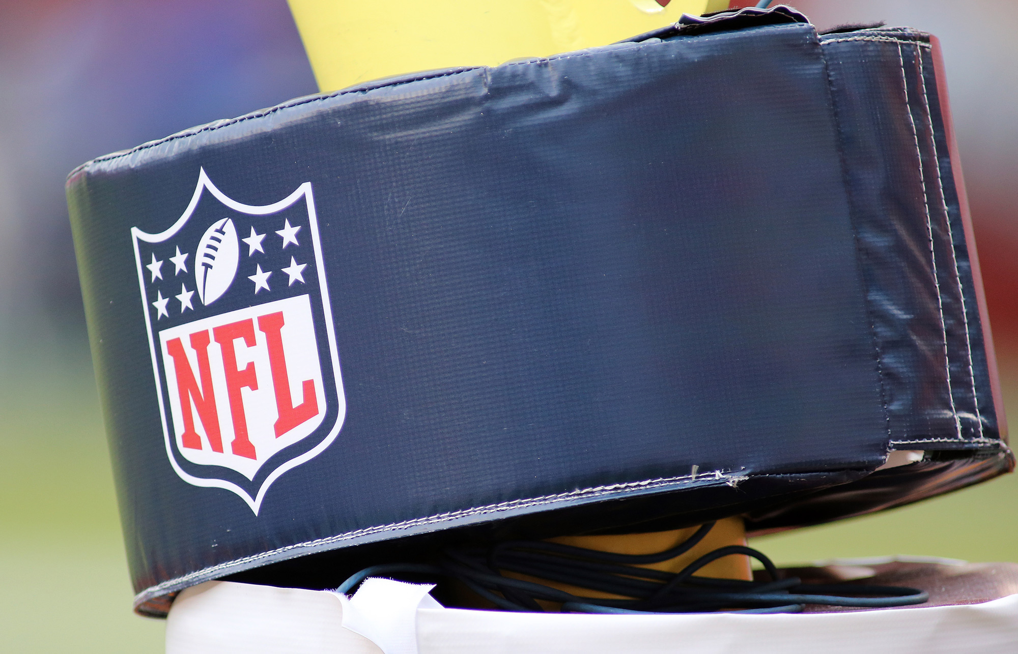 A close up an NFL football logo on a goalpost is seen during an NFL football game on October 11 in Landover, Maryland.