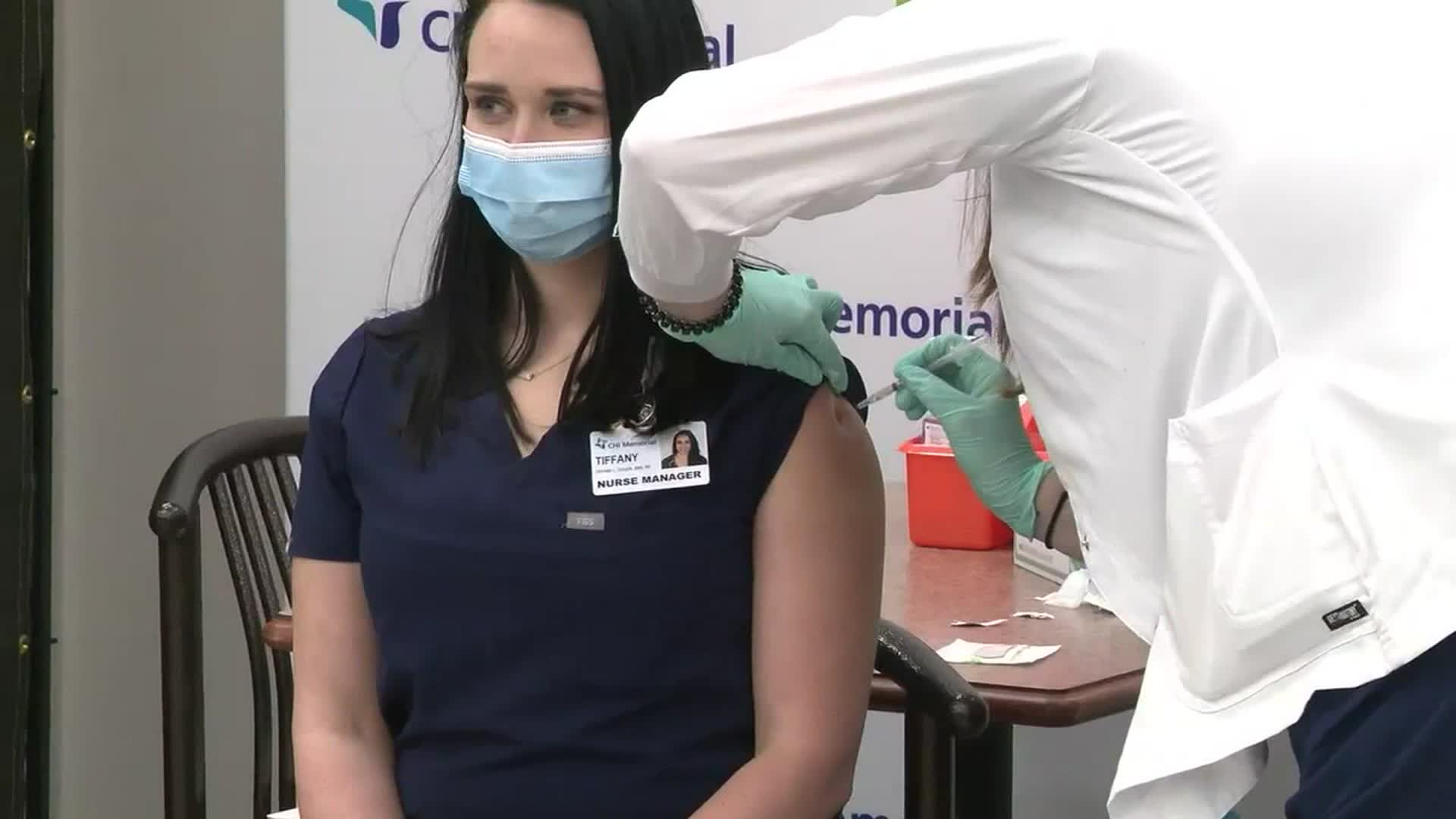 Nurse Manager Tiffany Dover receives the vaccine on Thursday.