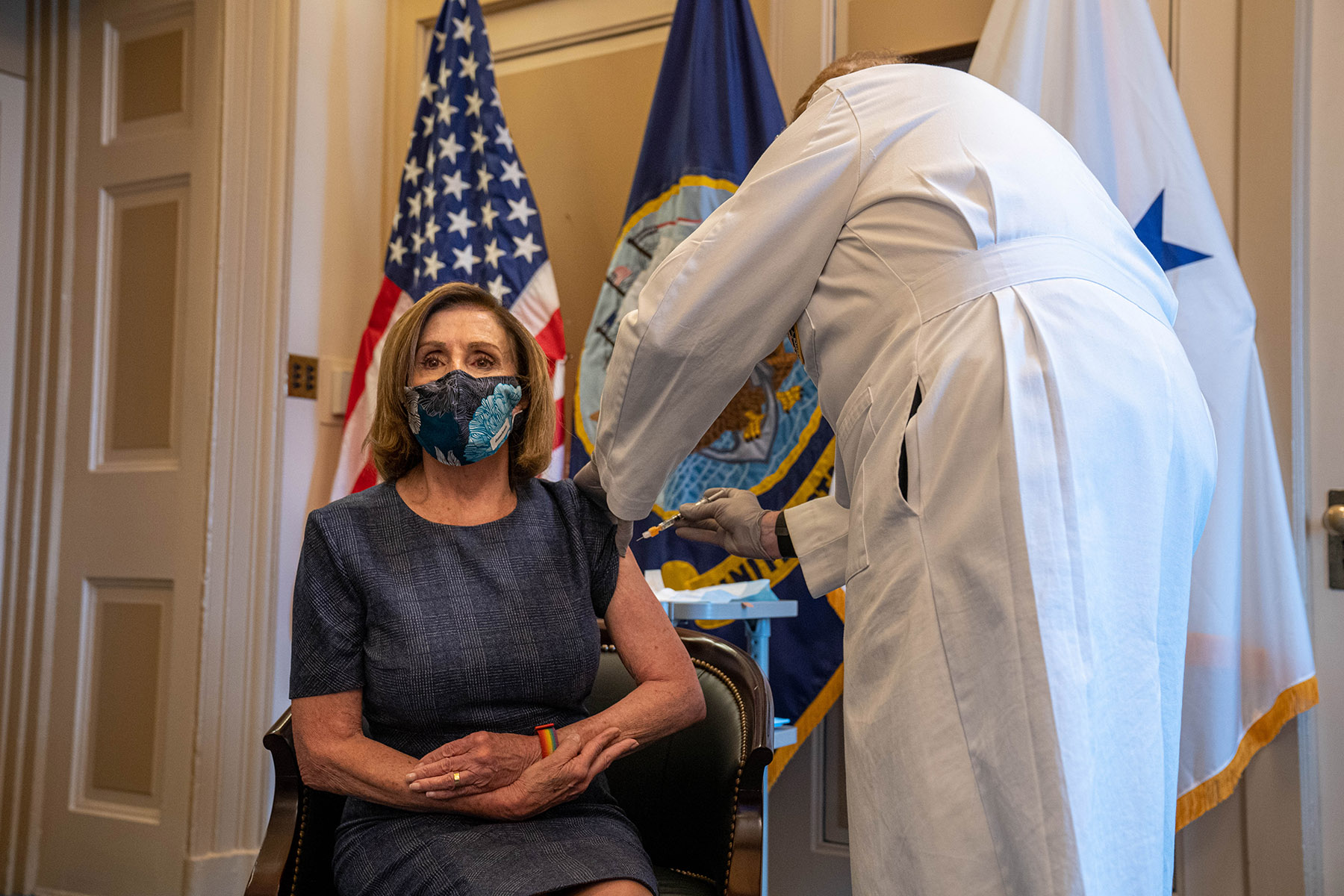 U.S. House Speaker Nancy Pelosi receives the Pfizer-BioNTech SE Covid-19 vaccine at the U.S. Capitol in Washington DC, on Friday, December 18.