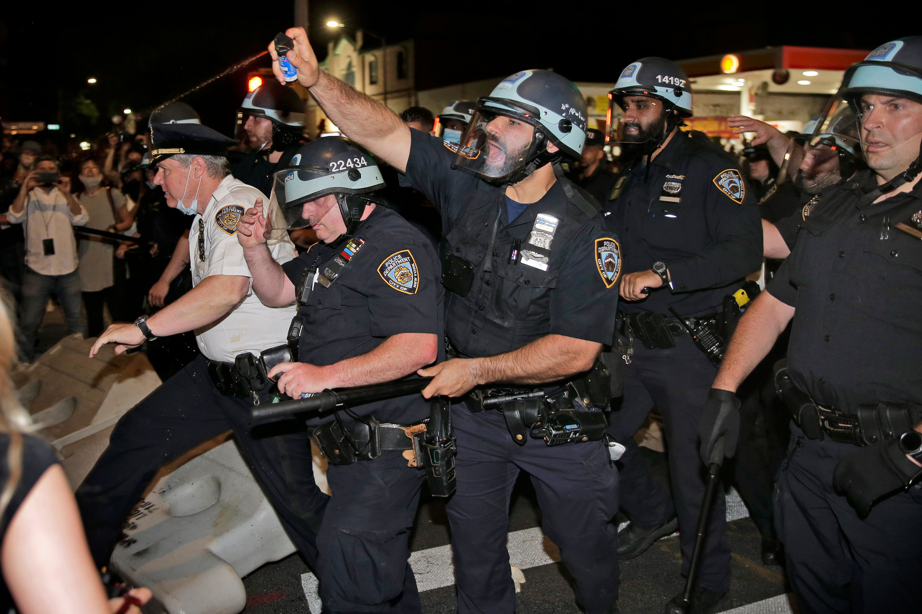 Police scuffle with protesters in Brooklyn on May 30.