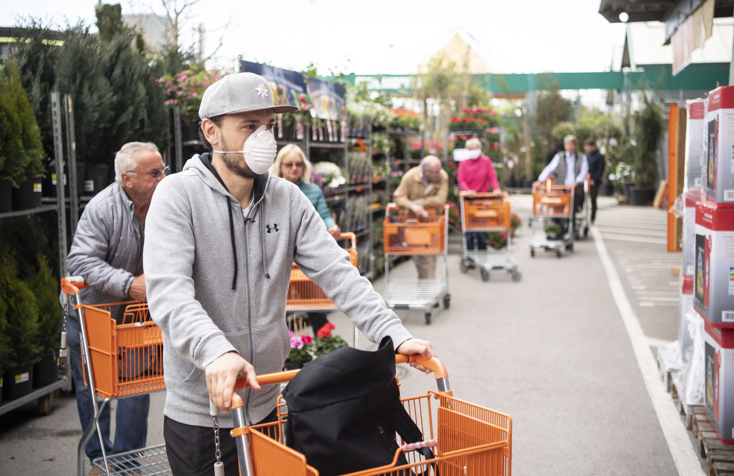 Customers wear protective face masks as they shop at a DIY-store in Munich, Bavaria, Germany, on April 20.
