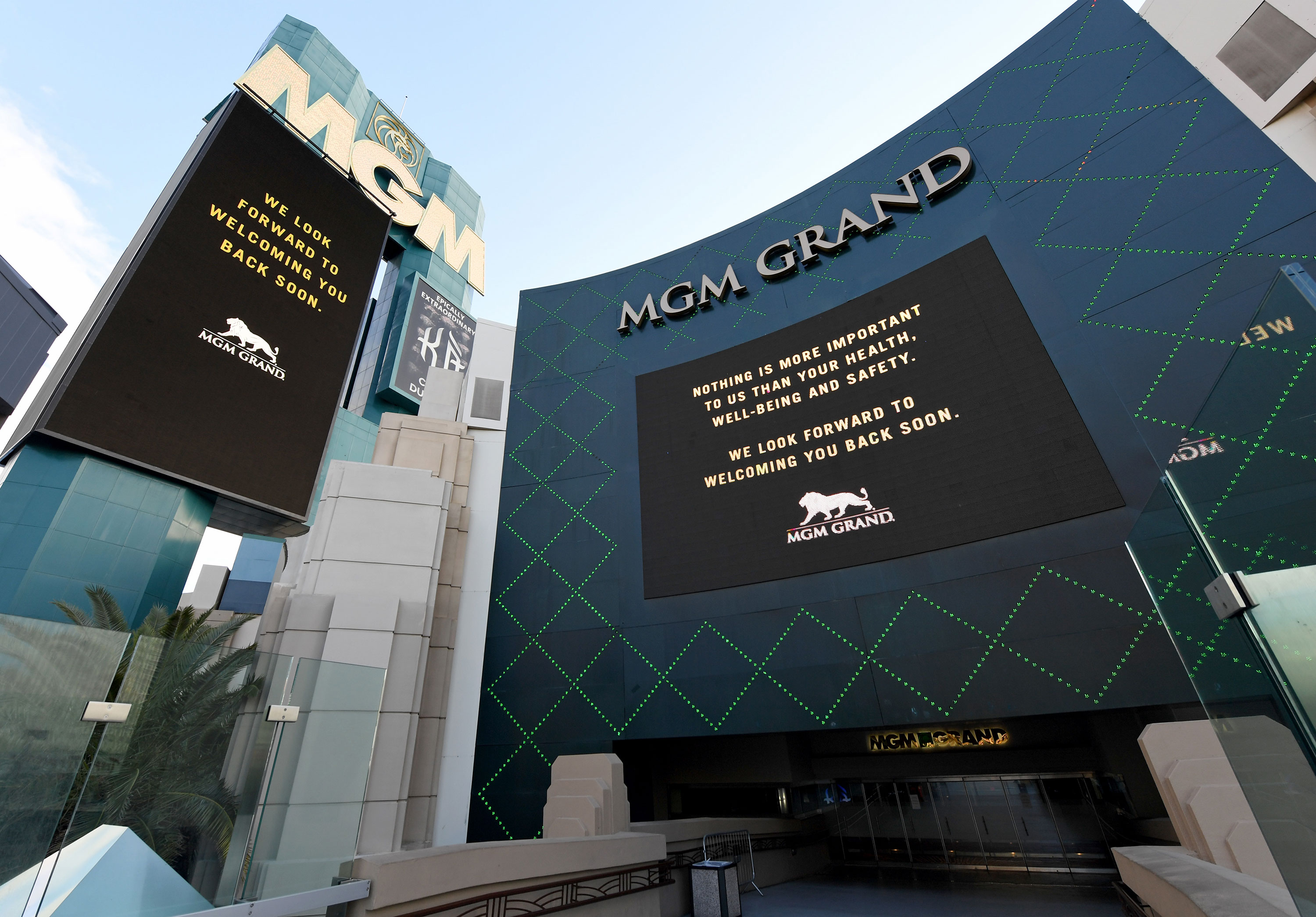 The marquee and sign at an entrance of the MGM Grand & Hotel & Casino display messages after the Las Vegas Strip resort was closed as a precaution against coronavirus on March 17 in Las Vegas.