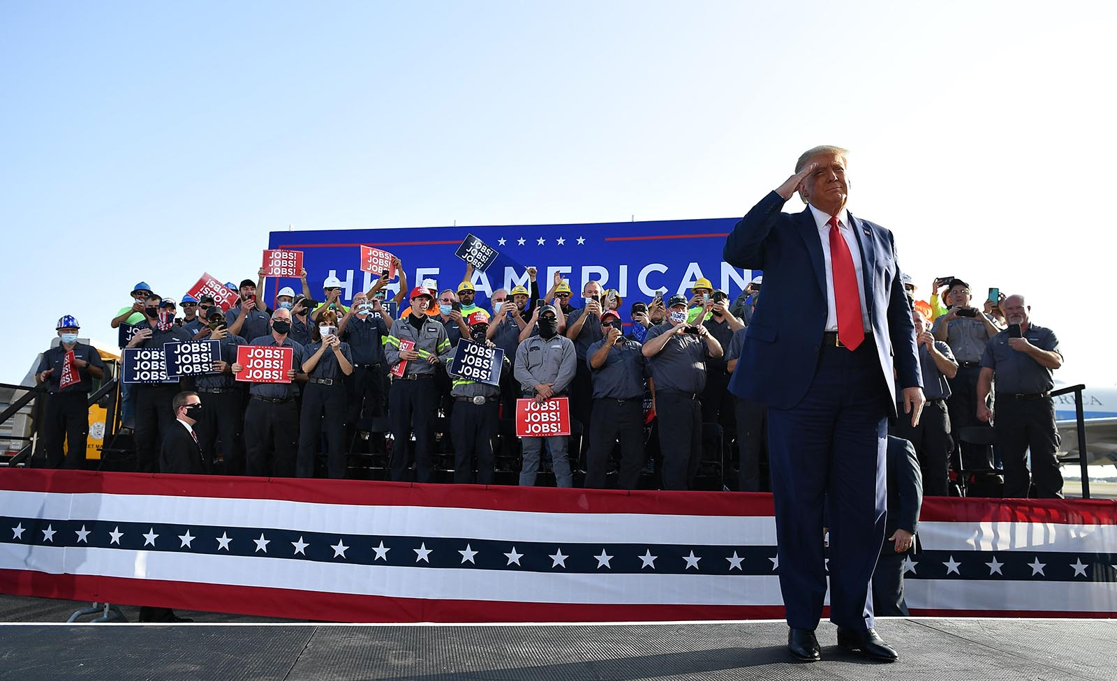 President Donald Trump salutes before a rally at Dayton International Airport in Dayton, Ohio, on September 21.