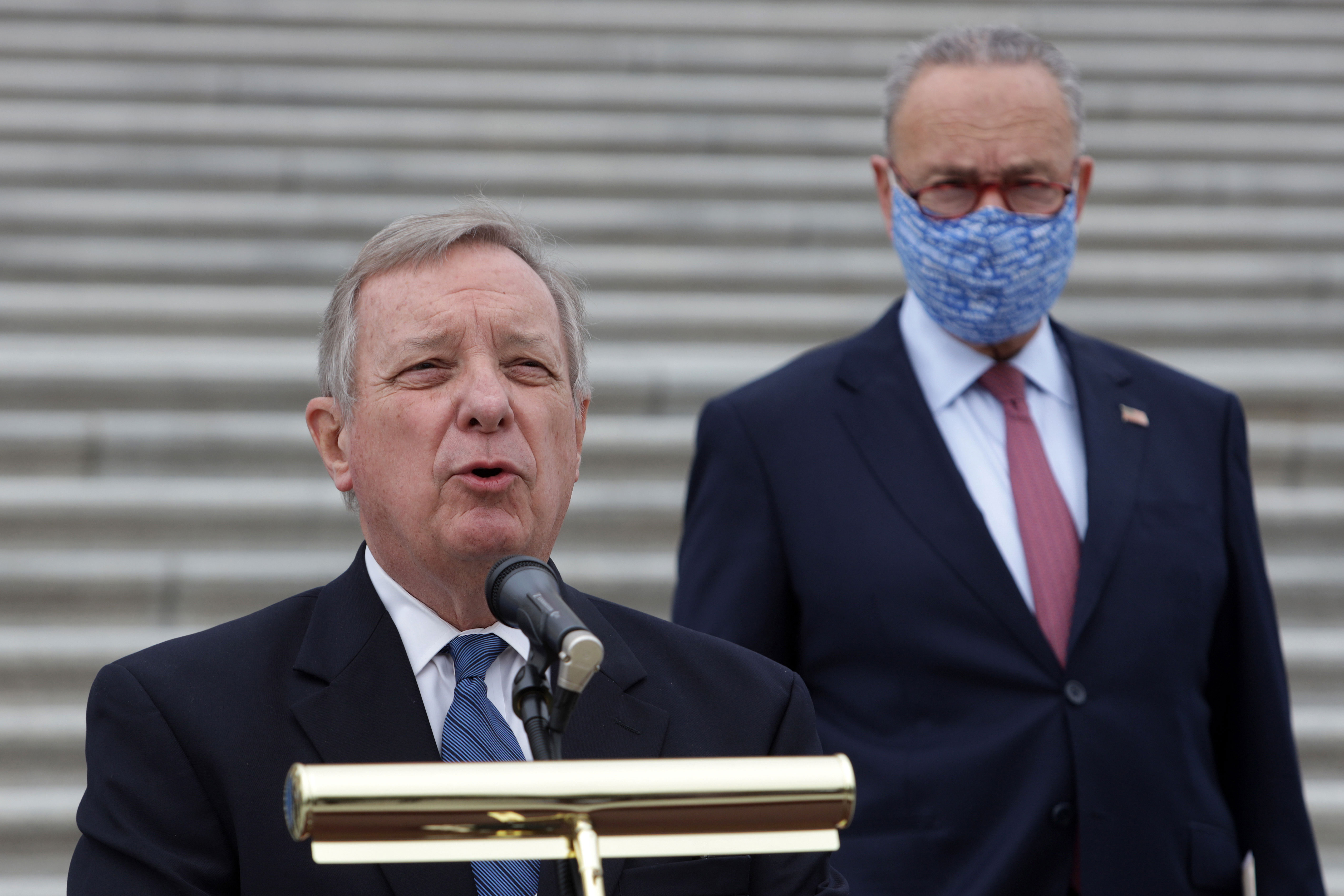 Sen. Dick Durbin, foreground, and Sen. Chuck Schumer attend a news conference in front of the Capitol on October 22.