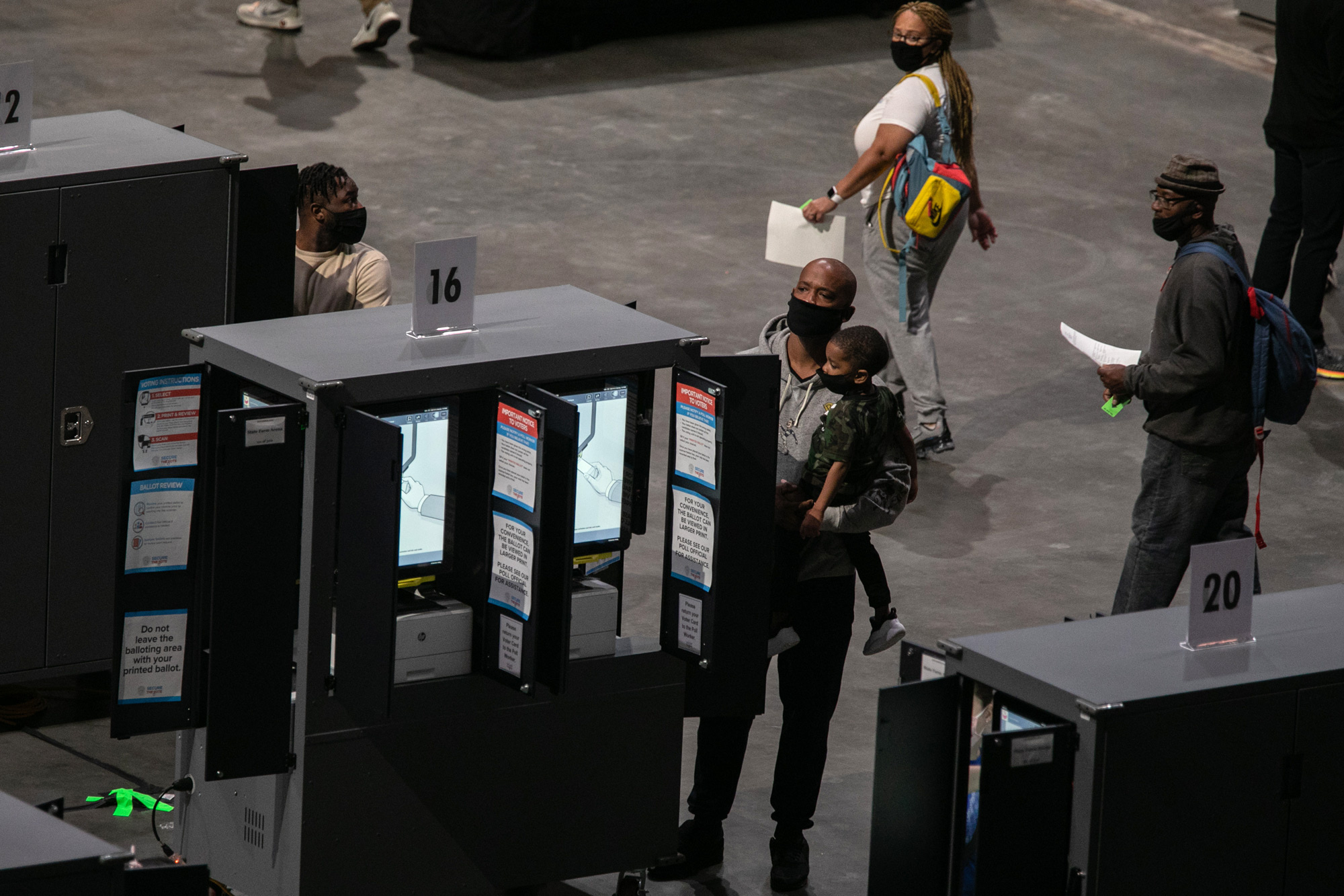 Voters cast their ballots inside of State Farm Arena for the first day of early voting in the general election on October 12 in Atlanta.
