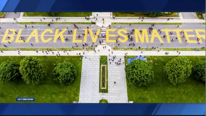 """Volunteers painted """"Black Lives Matter"""" in front of the Vermont statehouse Saturday."""