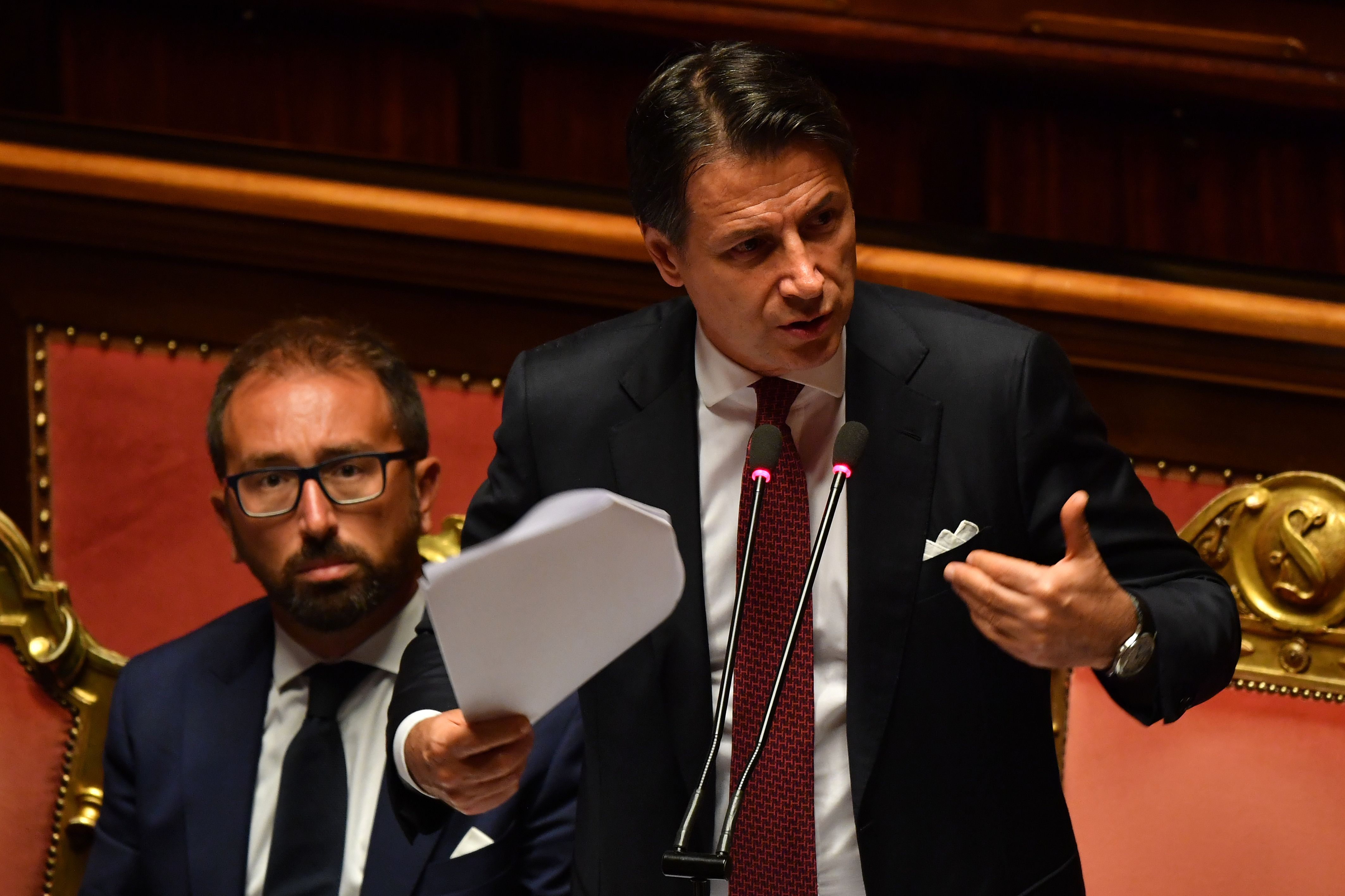 Italian Prime Minister Giuseppe Conte (R) gestures as he delivers a speech at the Italian Senate in Rome on Aug. 20, 2019.