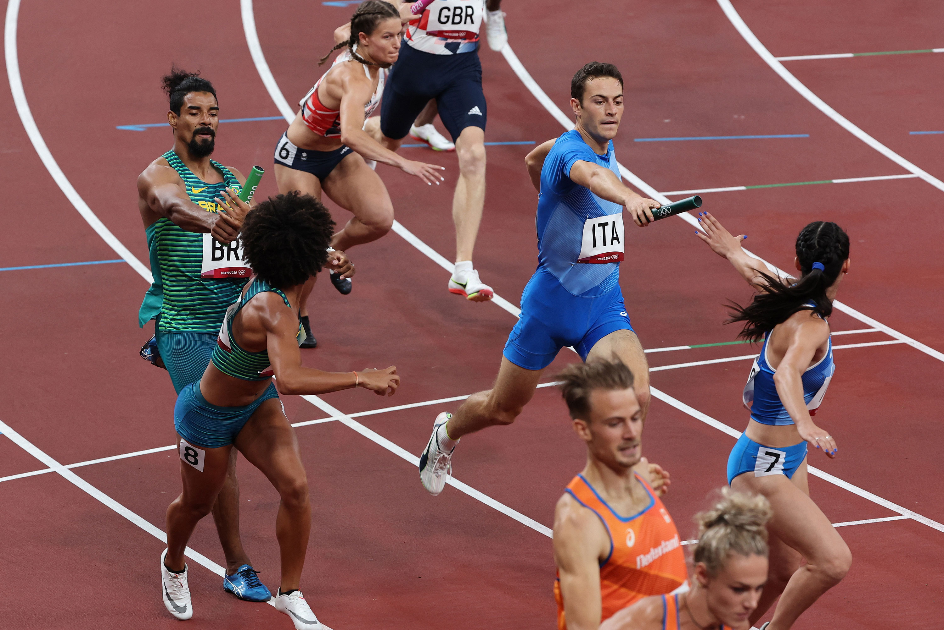 Athletes from Brazil, Great Britain, Italy and Netherlands compete in the mixed 4x400-meter relay heat on July 30.