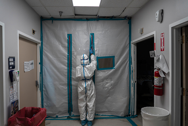 A medical staff exits the COVID-19 intensive care unit (ICU) at the United Memorial Medical Center on January 1, 2021 in Houston, Texas.