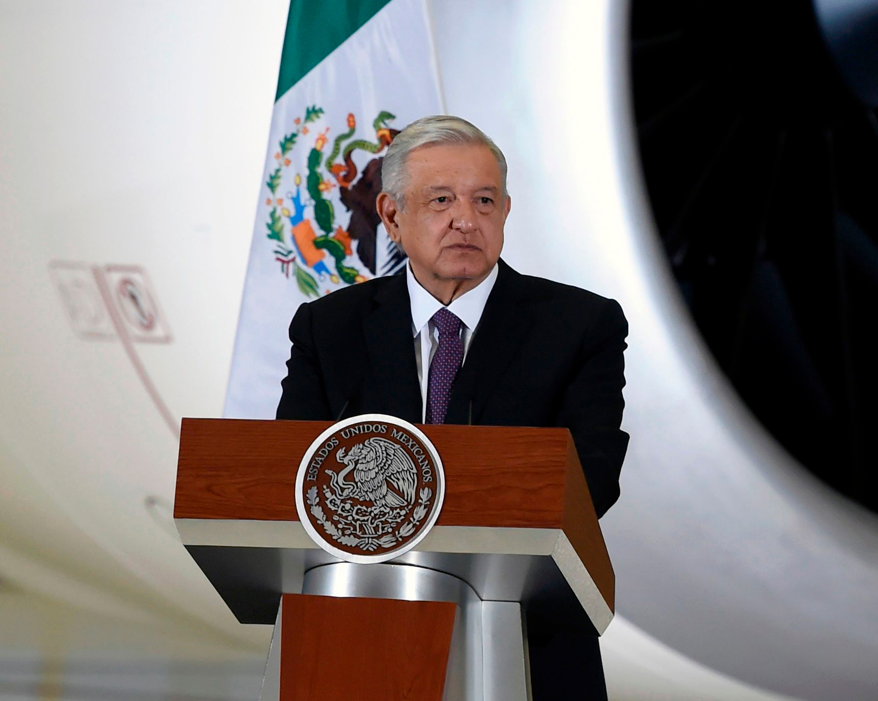 Mexican President Andres Manuel Lopez Obrador speaks during a press conference at the presidential hangar of the Benito Juarez International Airport in Mexico City on July 27.