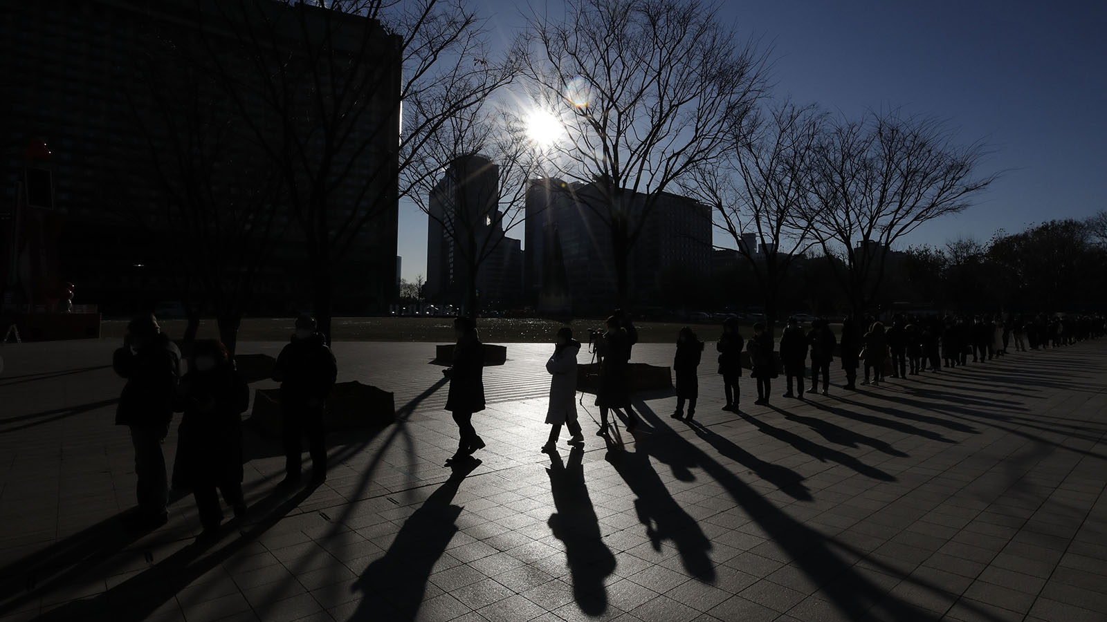 People queue in line to wait for coronavirus testing in Seoul, South Korea, on Thursday, December 17.