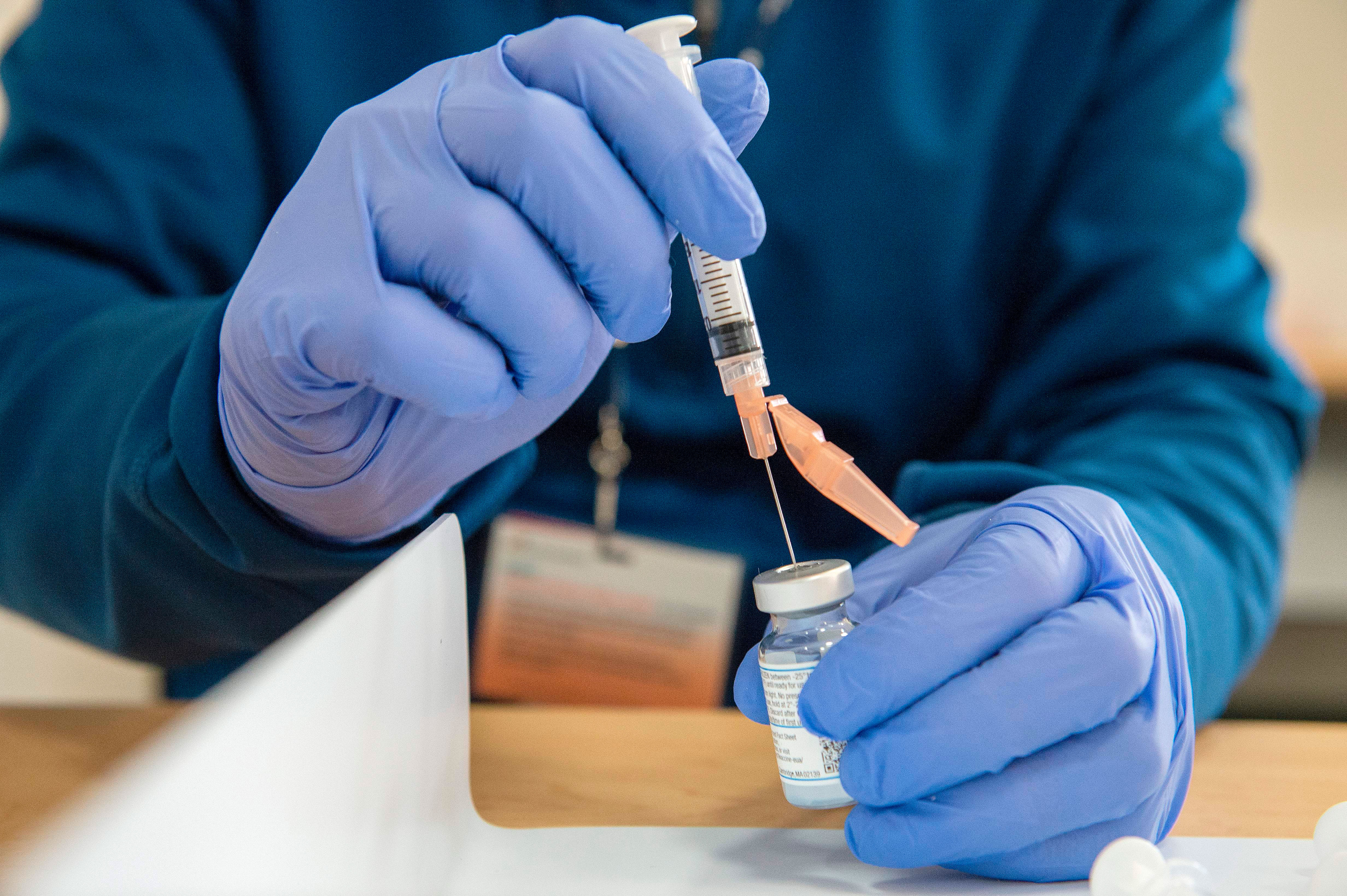 A pharmacist fills syringes with the Moderna Covid-19 vaccine at UMass Memorial hospital in Marlborough, Massachusetts, on January 12.