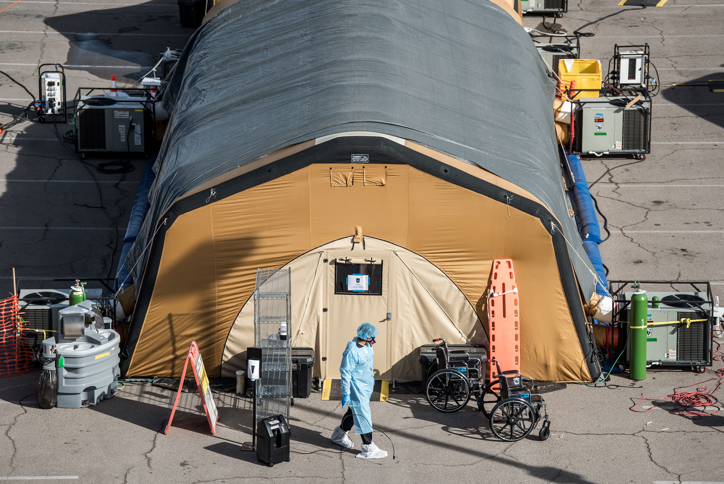 A nurse exits a tent for coronavirus patients at University Medical Center in El Paso, Texas, on October 30. Health care workers will be among the first to get the coronavirus vaccine.