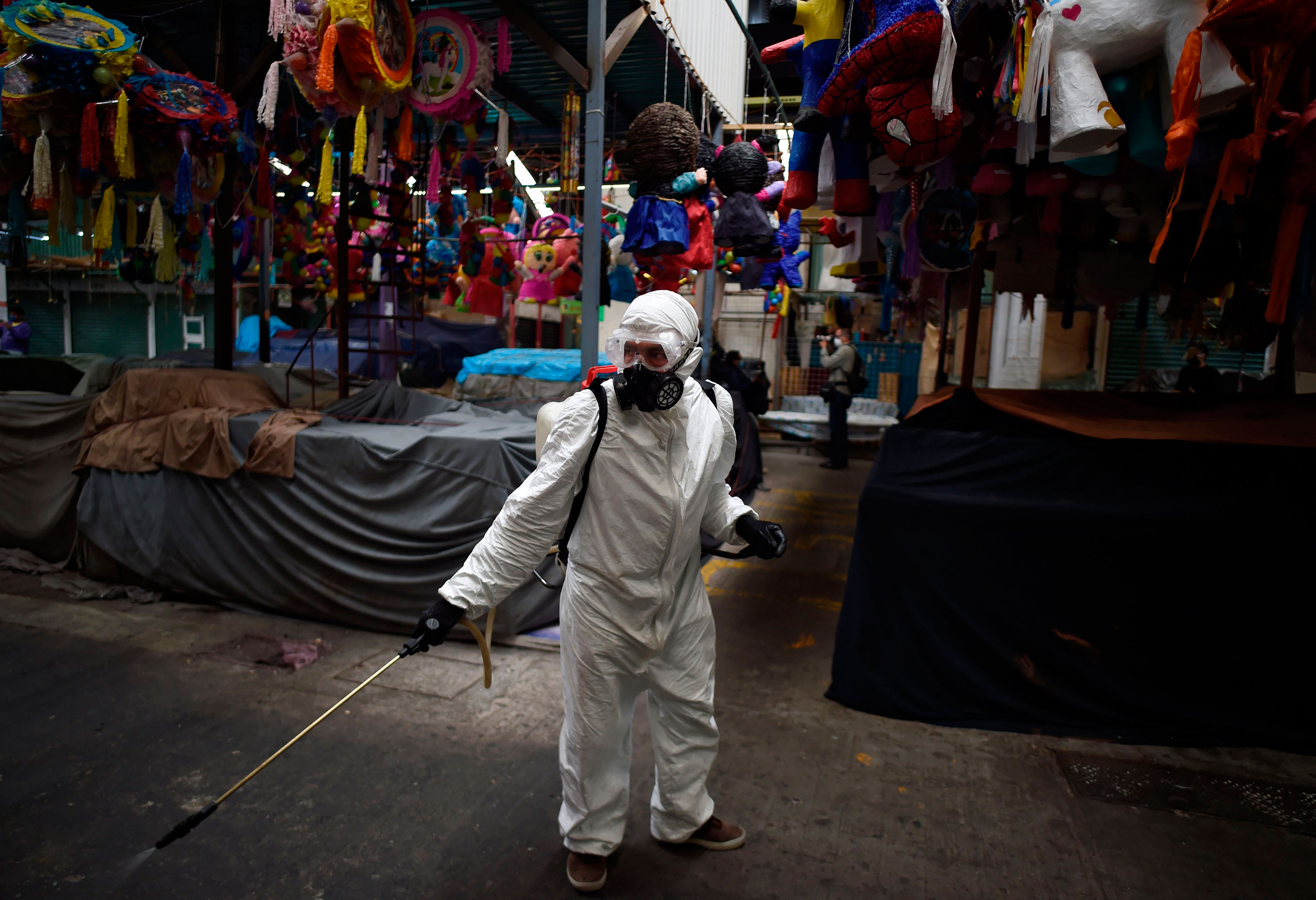 A worker disinfects a market in Mexico City on May 23 as a precaution against coronavirus.
