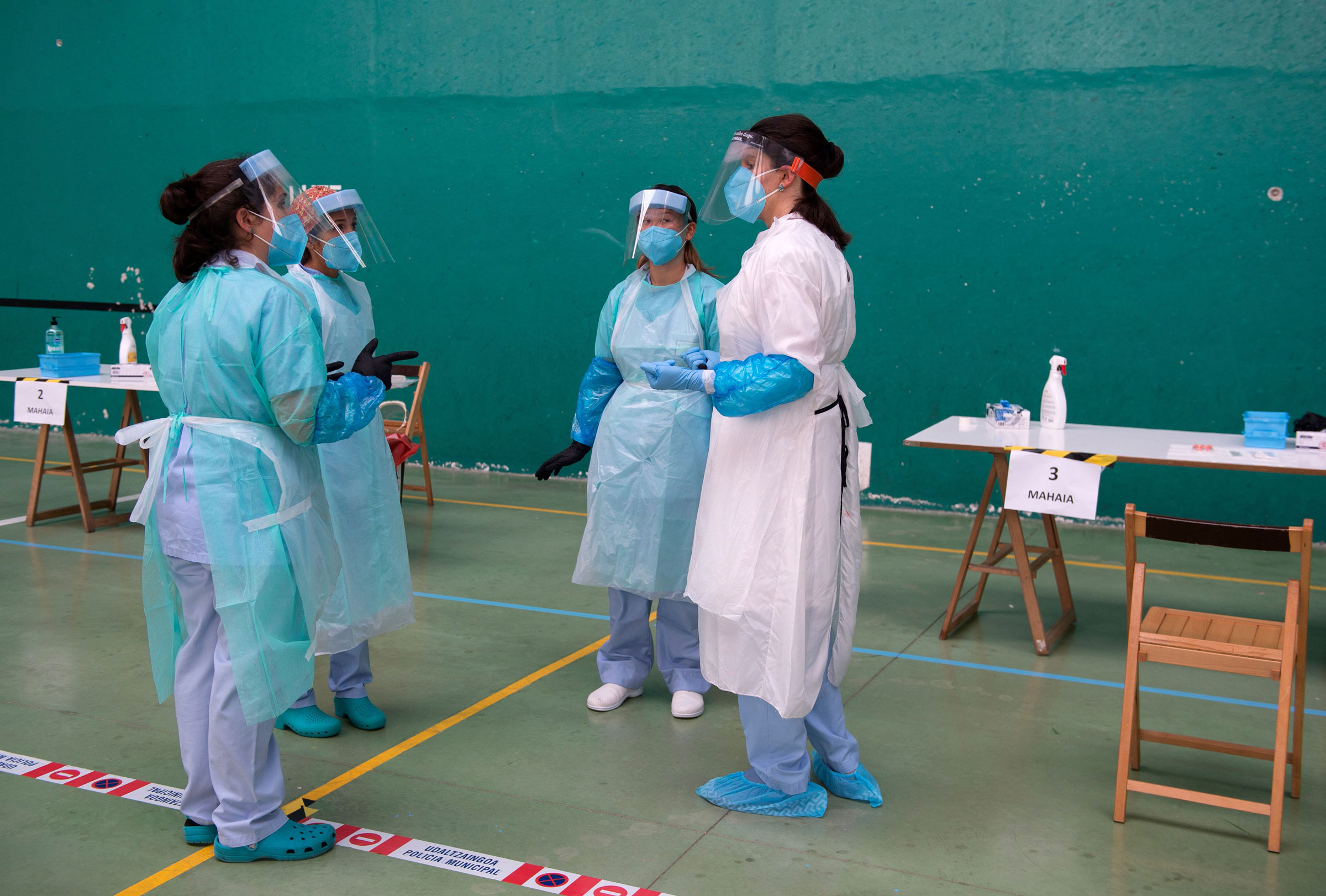 Health-care workers have a briefing at a temporary testing center in Getaria, Spain, on Wednesday.
