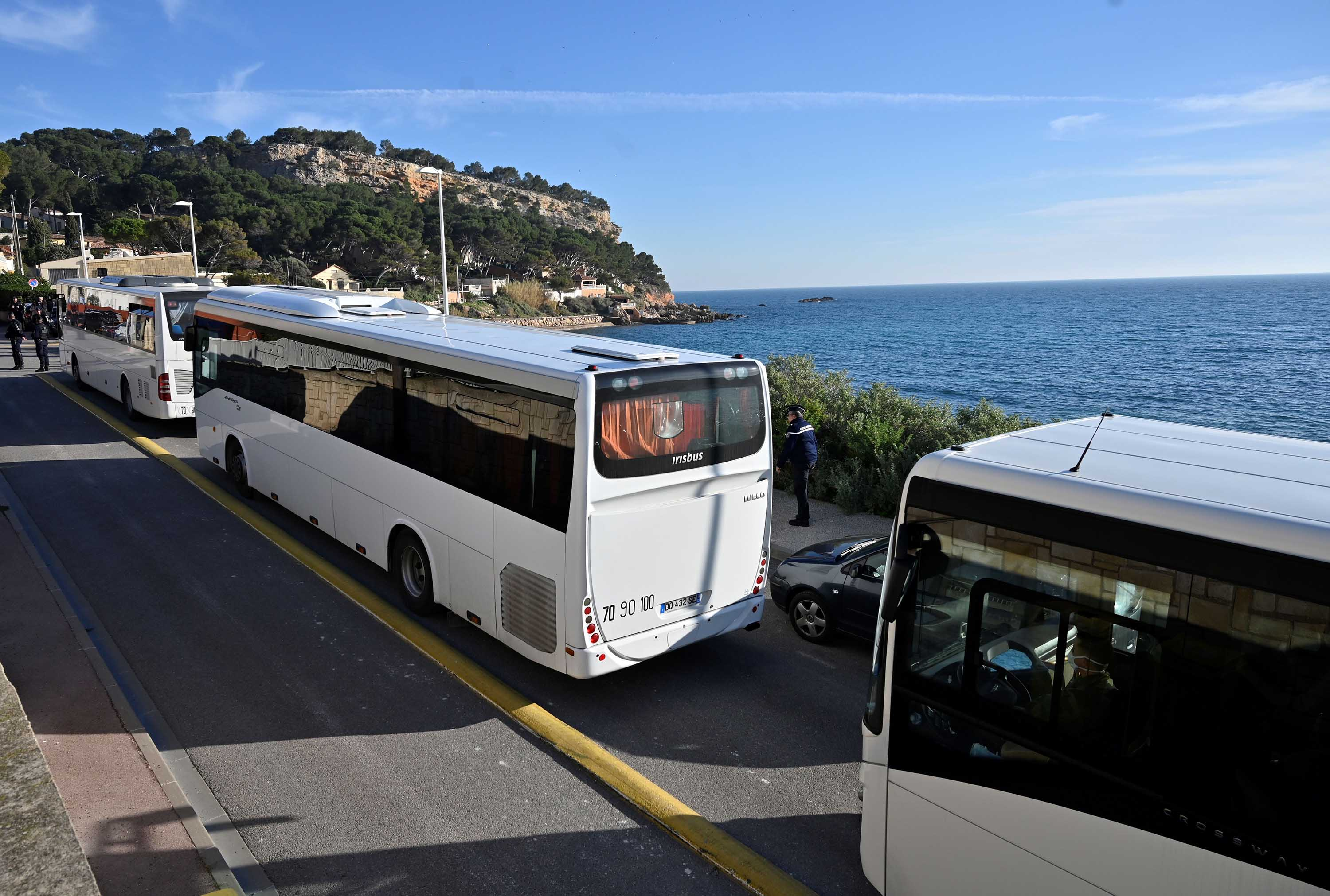 Buses believed to contain French citizens after their evacuation from the Chinese city of Wuhan arrive at the Vacanciel Holiday Resort in Carry-le-Rouet, near Marseille, France on Friday.