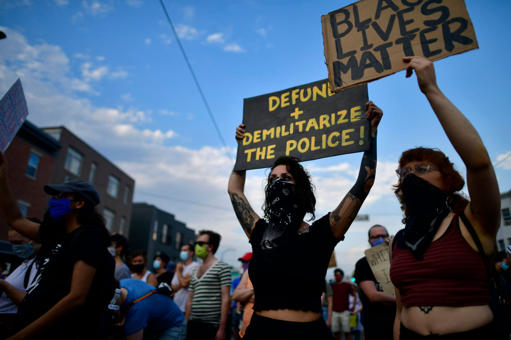 Activists gather in protest outside the 26th Police Precinct on June 3 in Philadelphia, Pennsylvania.