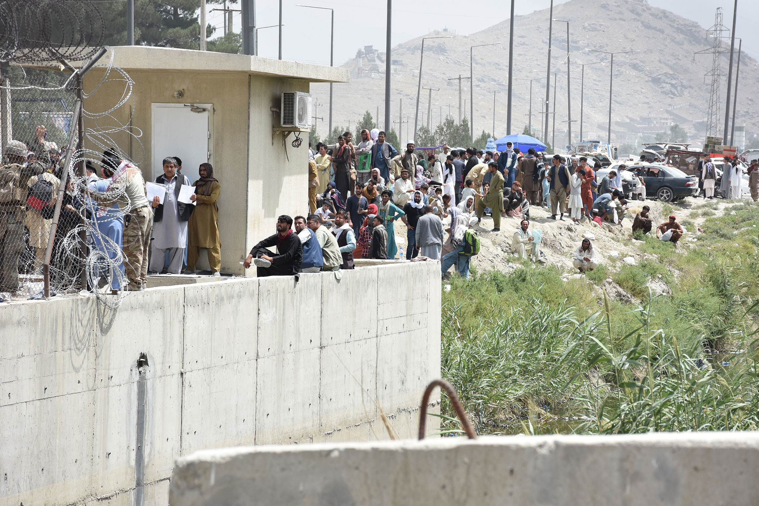 Afghans gather near the Kabul airport on August 18.