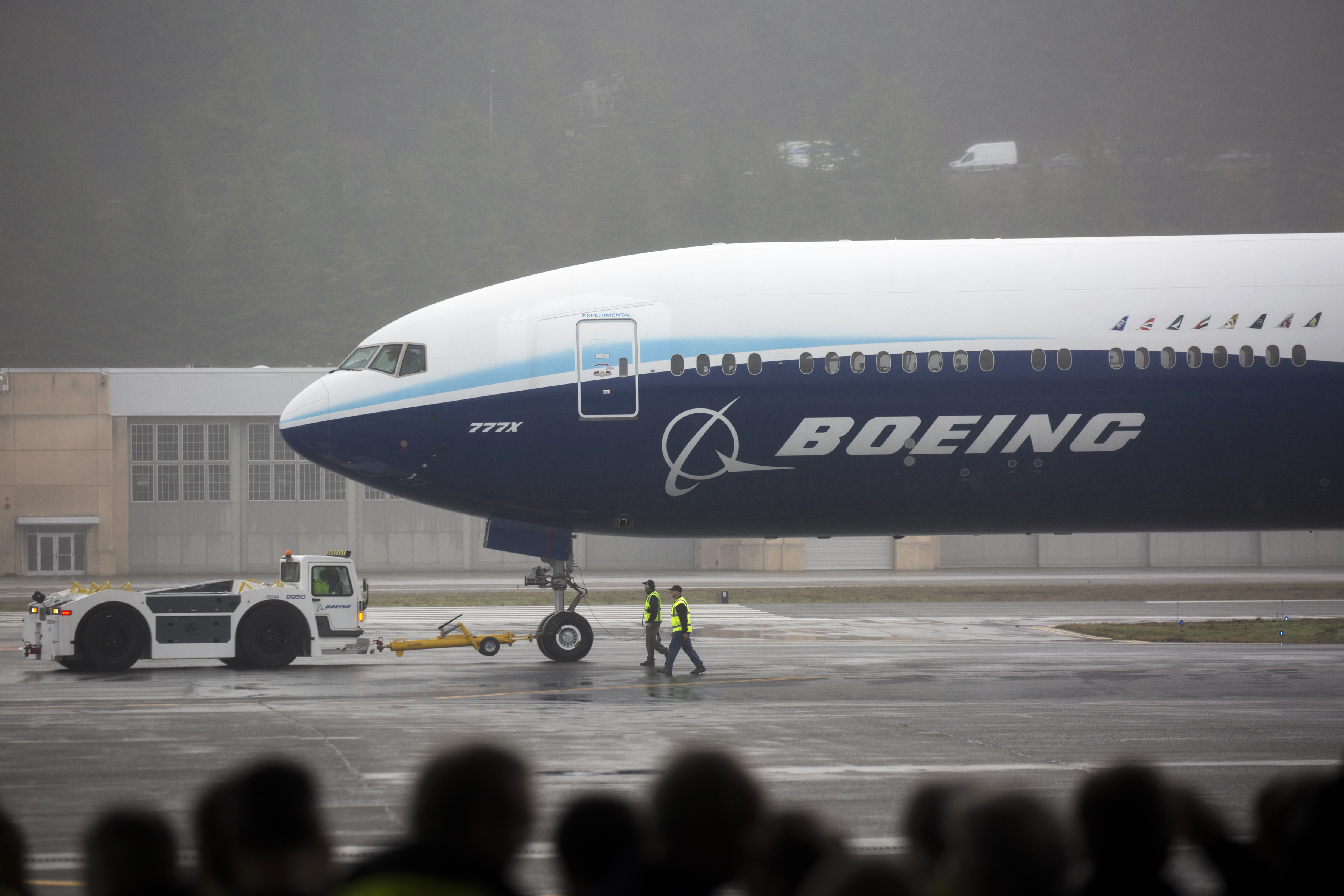 A Boeing 777X airplane returns from its inaugural flight at Boeing Field in Seattle, Washington, on January 25, 2020.