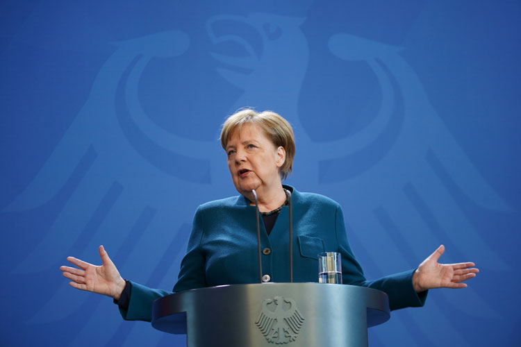 German Chancellor Angela Merkel speaks to the media to announce further measures to combat the spread of the coronavirus after she held a teleconference with the governors of Germany's 16 states on March 22 in Berlin, Germany.