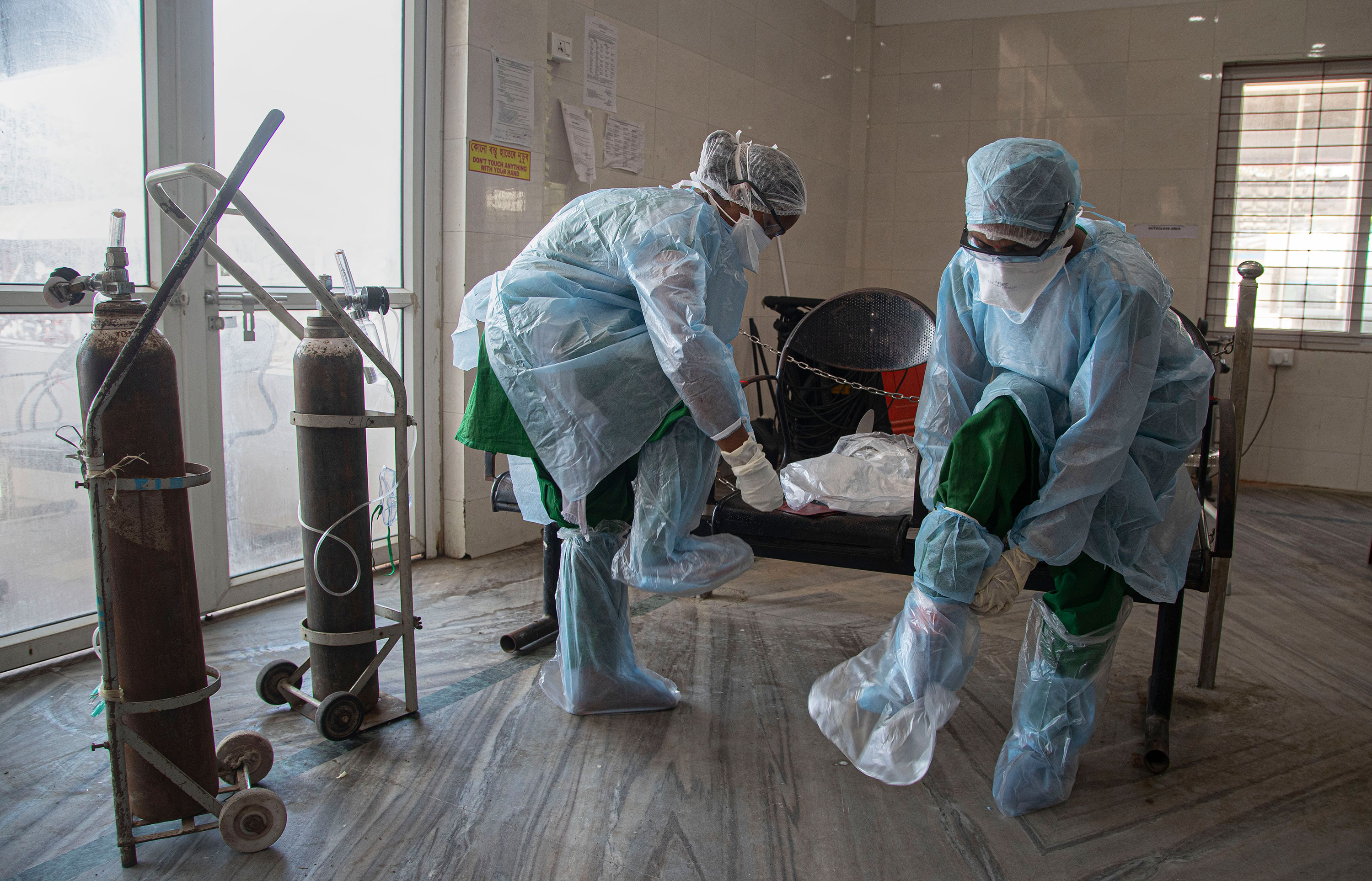 Health workers put on personal protective equipment before their shift at a Covid-19 check area in Gauhati, India, on May 1.