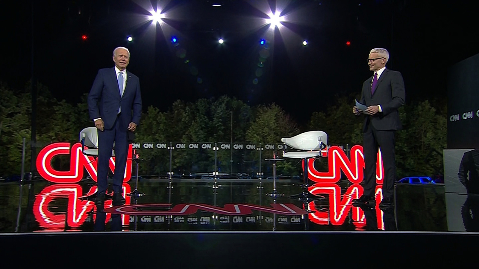 Democratic presidential nominee Joe Biden and CNN's Anderson Cooper speak on stage at the CNN Presidential Town Hall in Scranton, Pennsylvania, on Thursday.