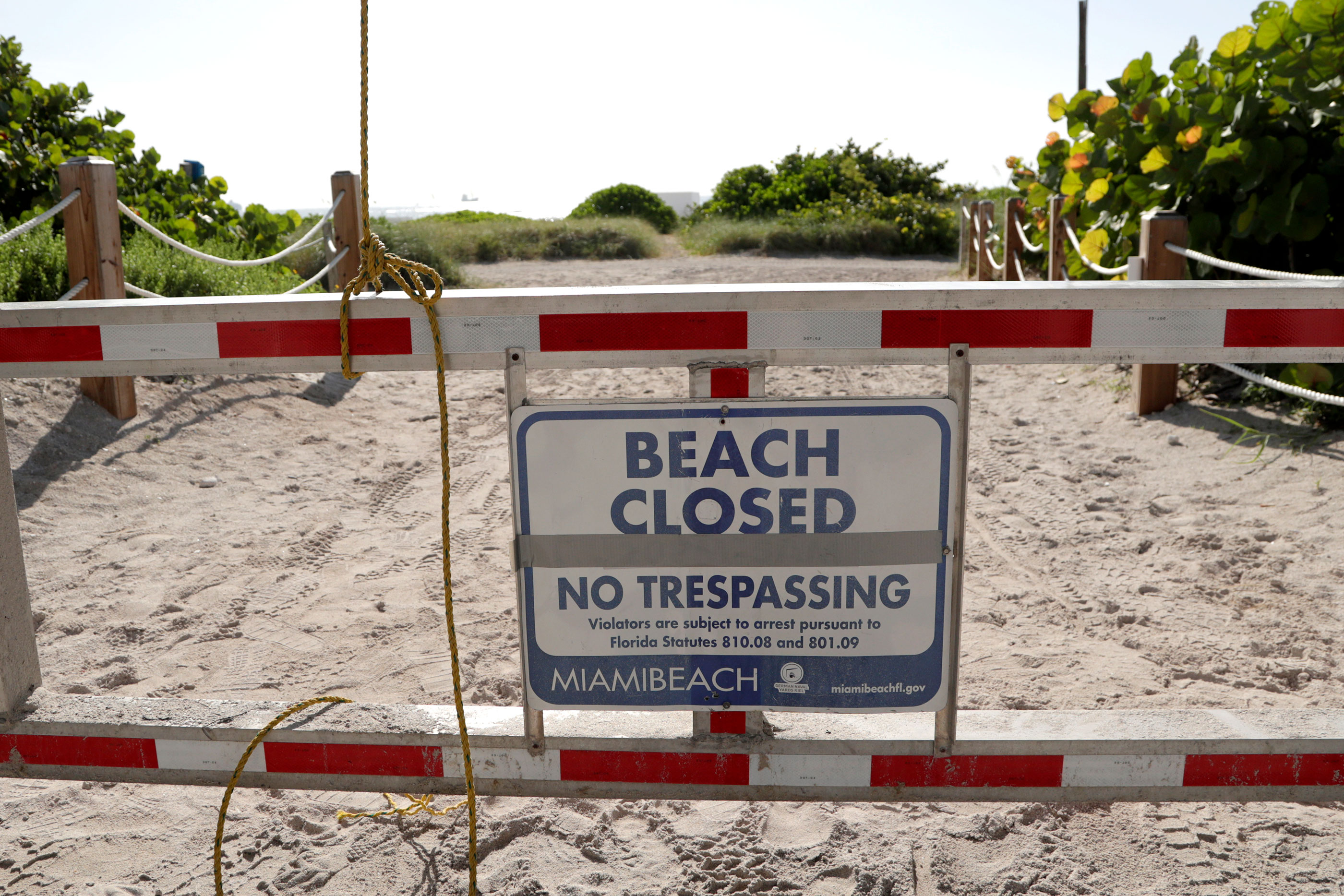 A sign is posted at a closed entrance to the beach on July 3 in the South Beach neighborhood of Miami Beach, Florida.