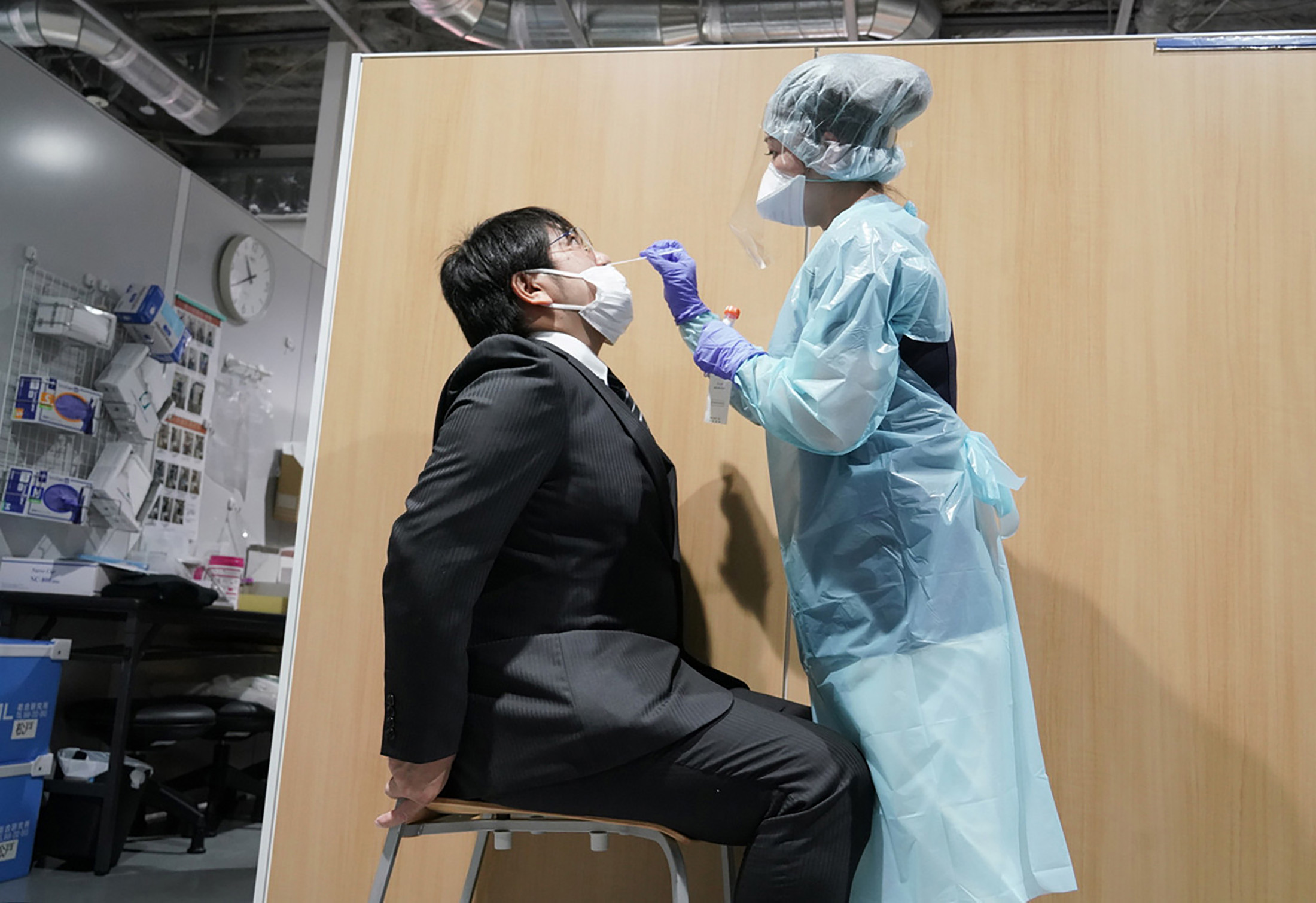 A medical staff member conducts a test for the coronavirus at the testing center at the Narita Airport in Narita, Japan, on November 2.