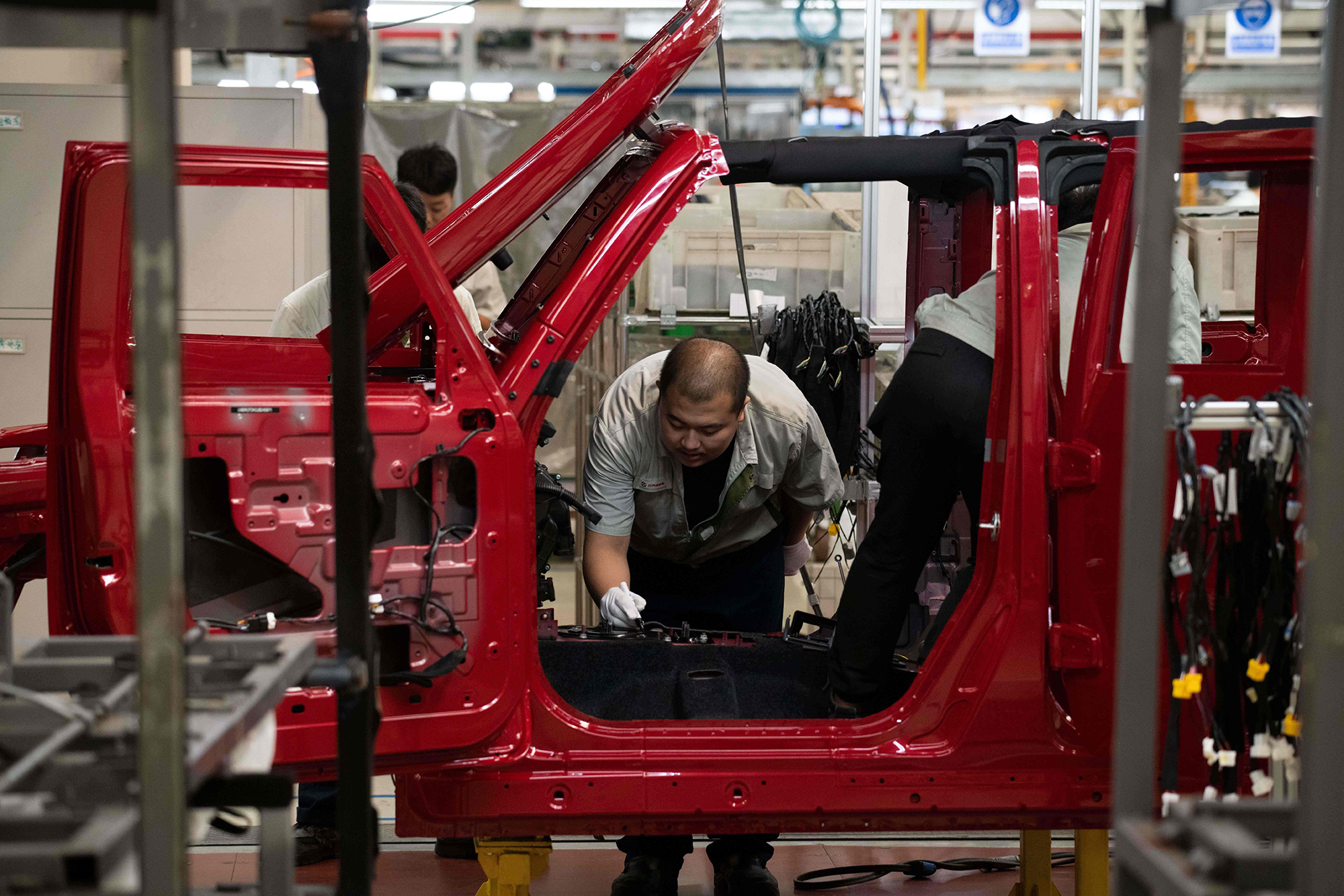 An employee works on an SUV production line on the Beijing Automotive Group Co. on August 29, 2018.